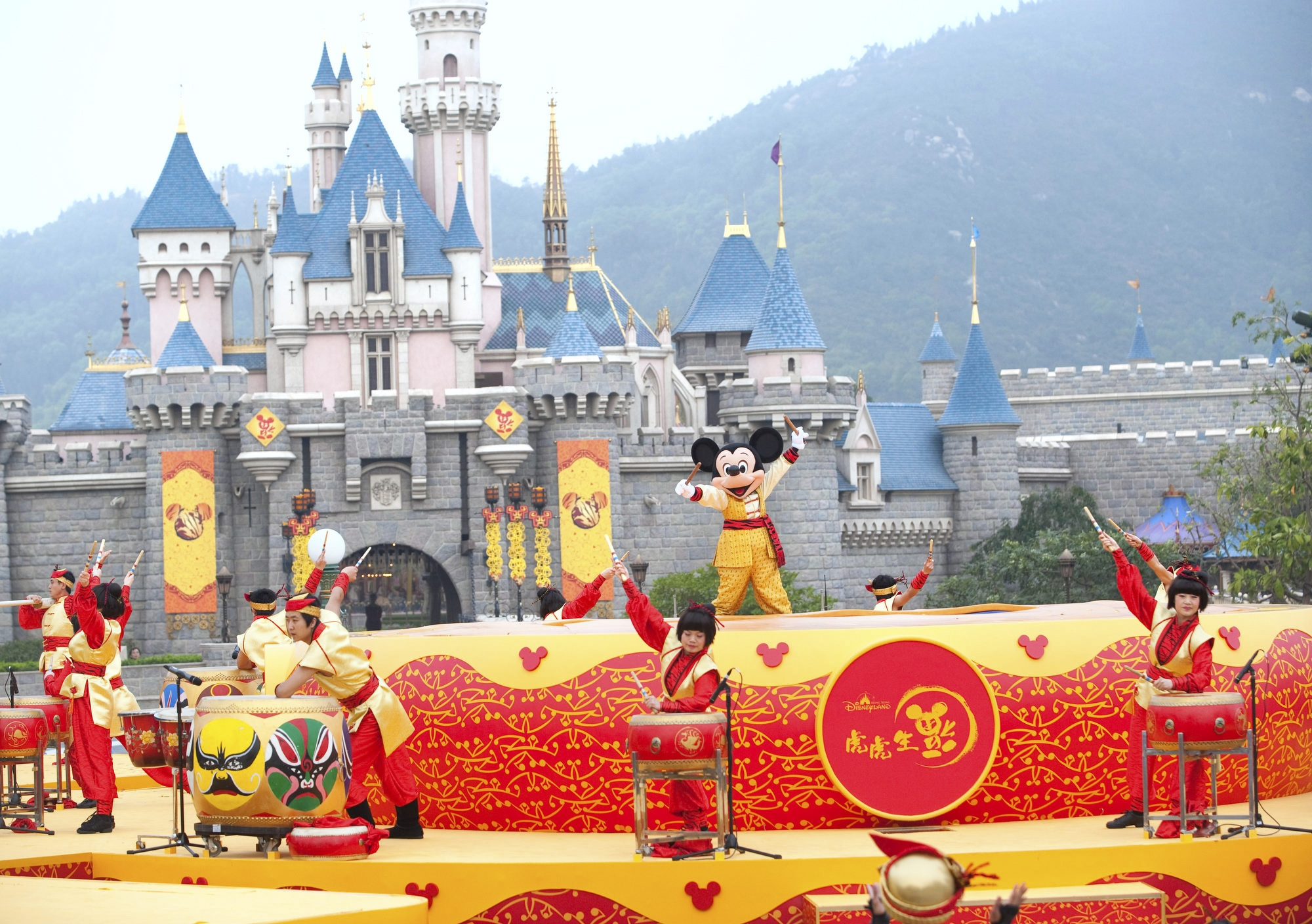 PHOTO MOVED IN ADVANCE AND NOT FOR USE - ONLINE OR IN PRINT - BEFORE NOV. 23, 2014.  In an undated handout photo, a performance at Hong Kong Disneyland. Visiting all 13 Disney parks takes endurance and curiosity about the effect of cultures on a trademark. (Disney via The New York Times) -- NO SALES; FOR EDITORIAL USE ONLY WITH STORY SLUGGED ALL DISNEY PARKS ADV23 BY BROOKS BARNES. ALL OTHER USE PROHIBITED. --