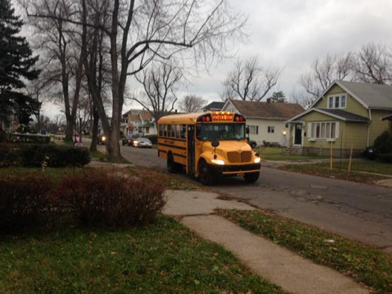 A school bus makes its rounds this morning on Shirley Avenue as Buffalo Public Schools reopened after closing several days during monster storm. (John Hickey/Buffalo News)