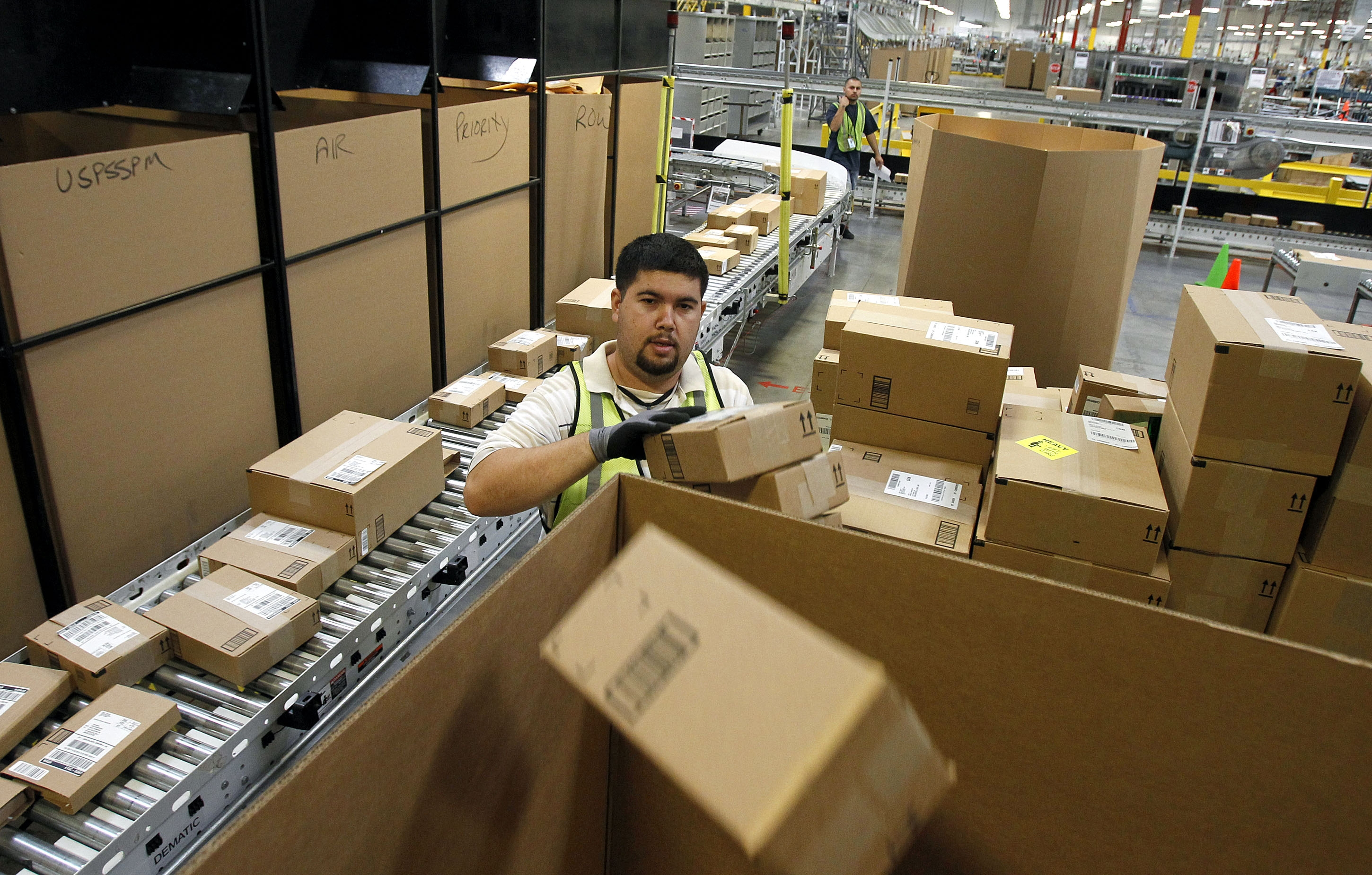 Amazon's fulfillment center in Phoenix is a hub in the online retailer's network that's gearing up for faster-than-ever delivery for the holidays.
