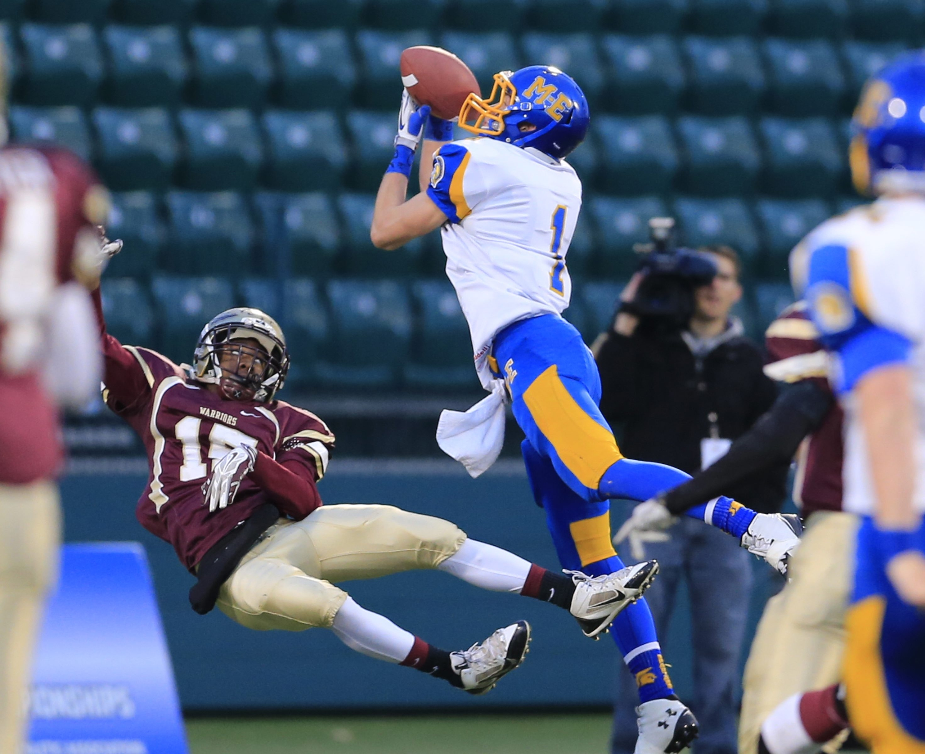Cheektowaga's Christian Bogle loses his balance as Maine-Endwell's Mike Palmer makes a touchdown catch Sunday.