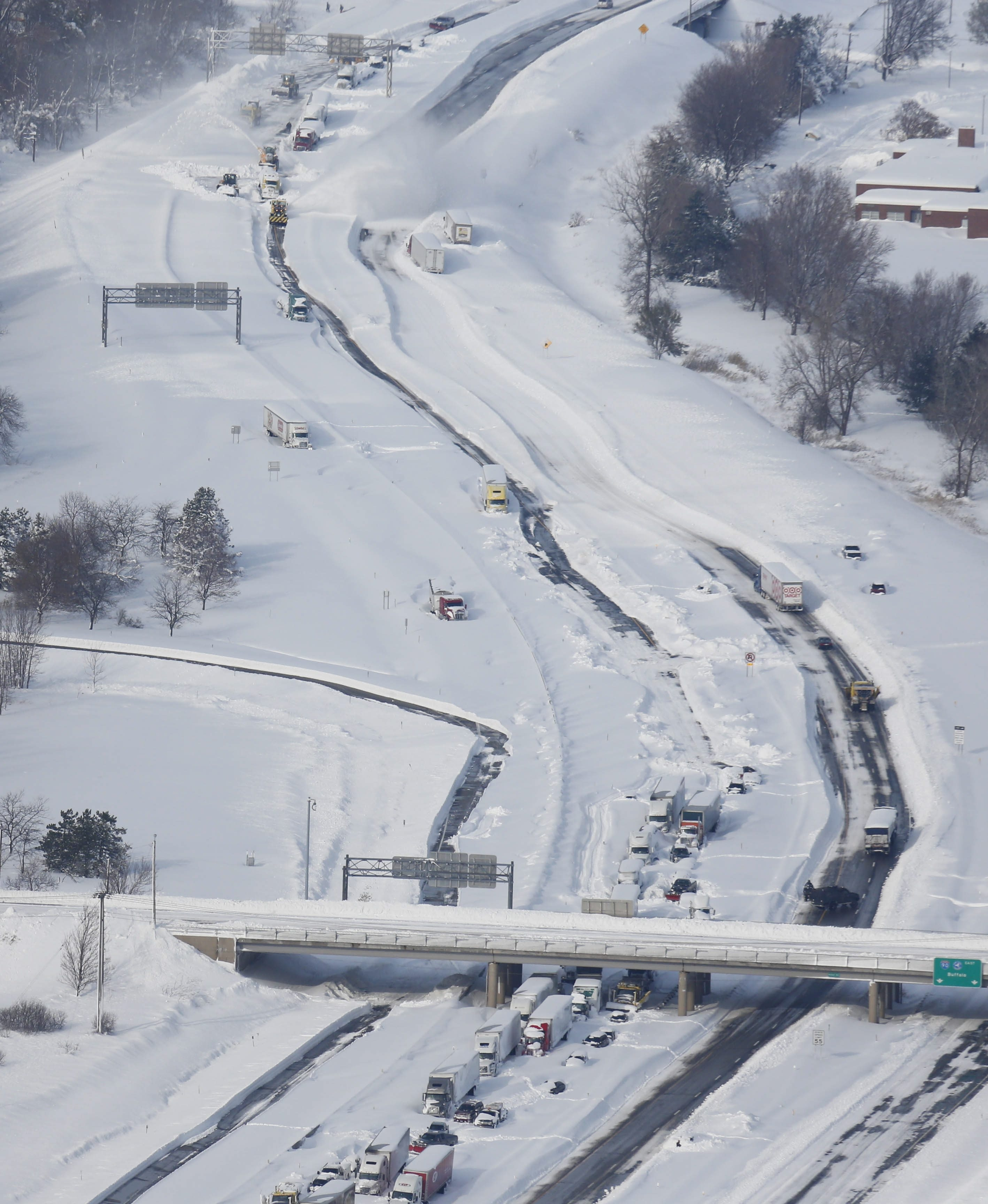 Crews continue work to free motorists stranded on the New York State Thruway near Ridge Road, Wednesday, Nov. 19, 2014.  (Derek Gee/Buffalo News)