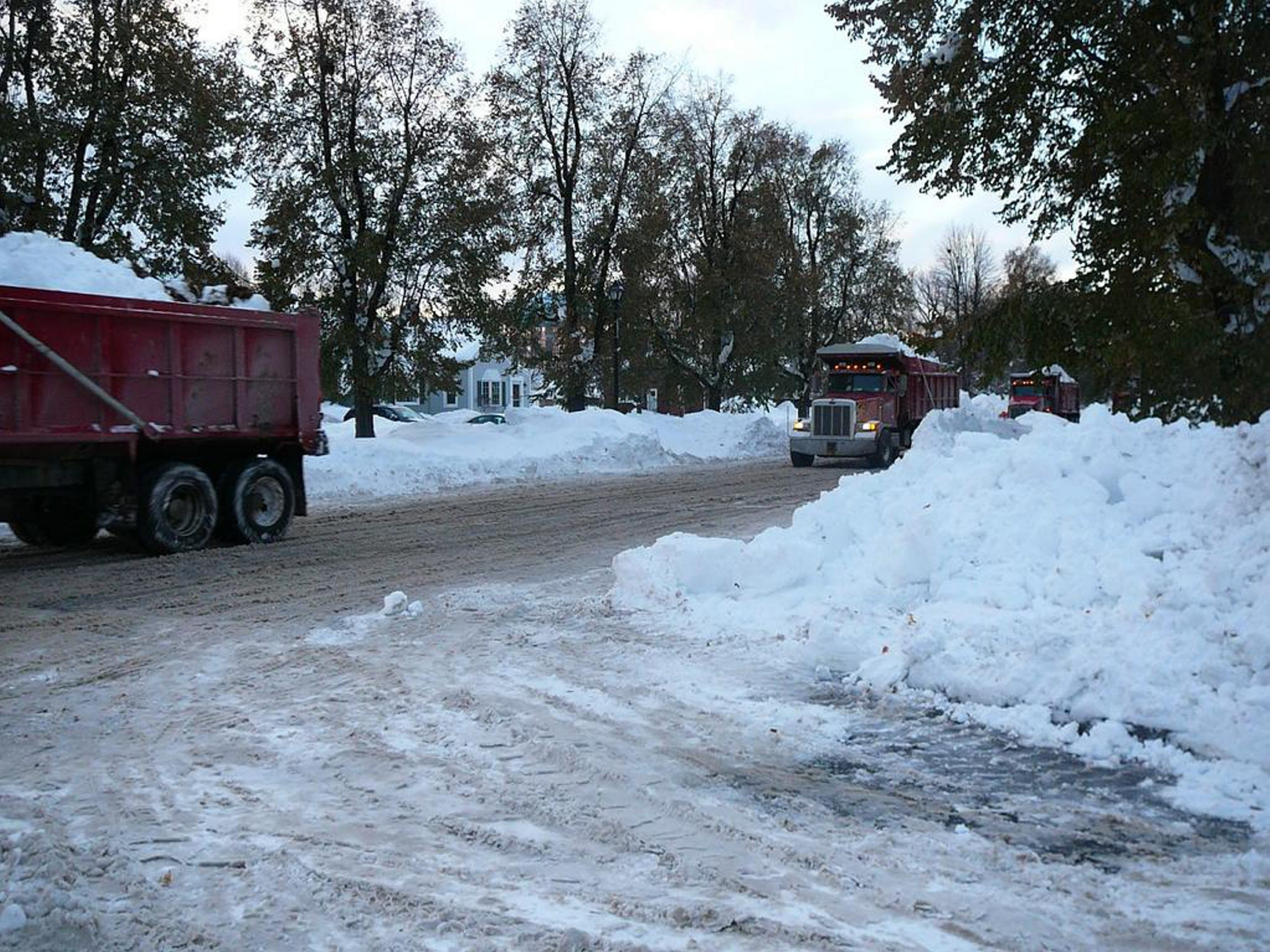 Five dump trucks filled with snow travel on McKinley Parkway and Eden Street in South Buffalo early Saturday morning. A travel ban is still in place for South Buffalo. (Toni Ruberto)