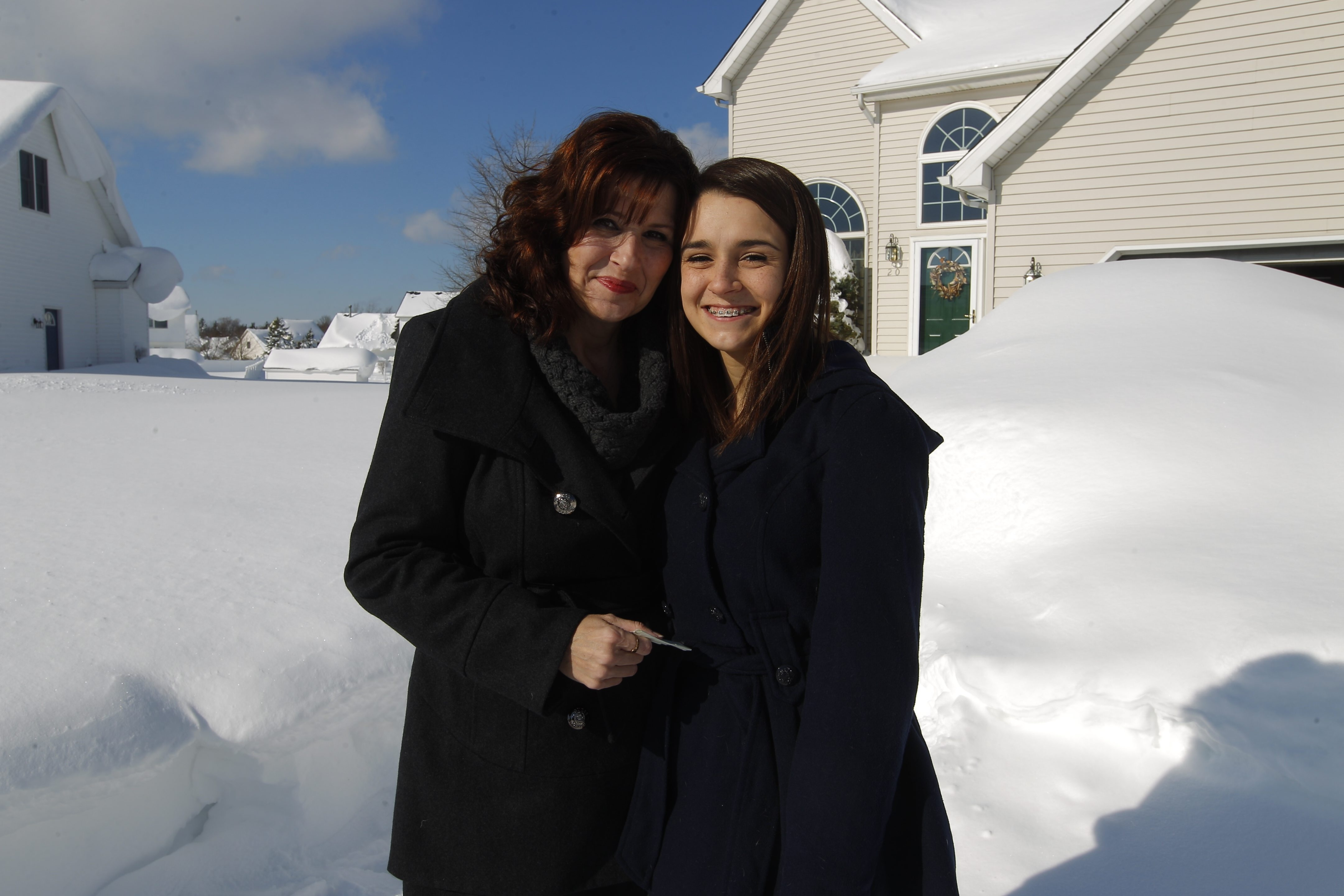 Karen Rossi was happily reunited with her daughter, Madelyn, 17, after spending 13 hours trapped in a snowbank in her car.