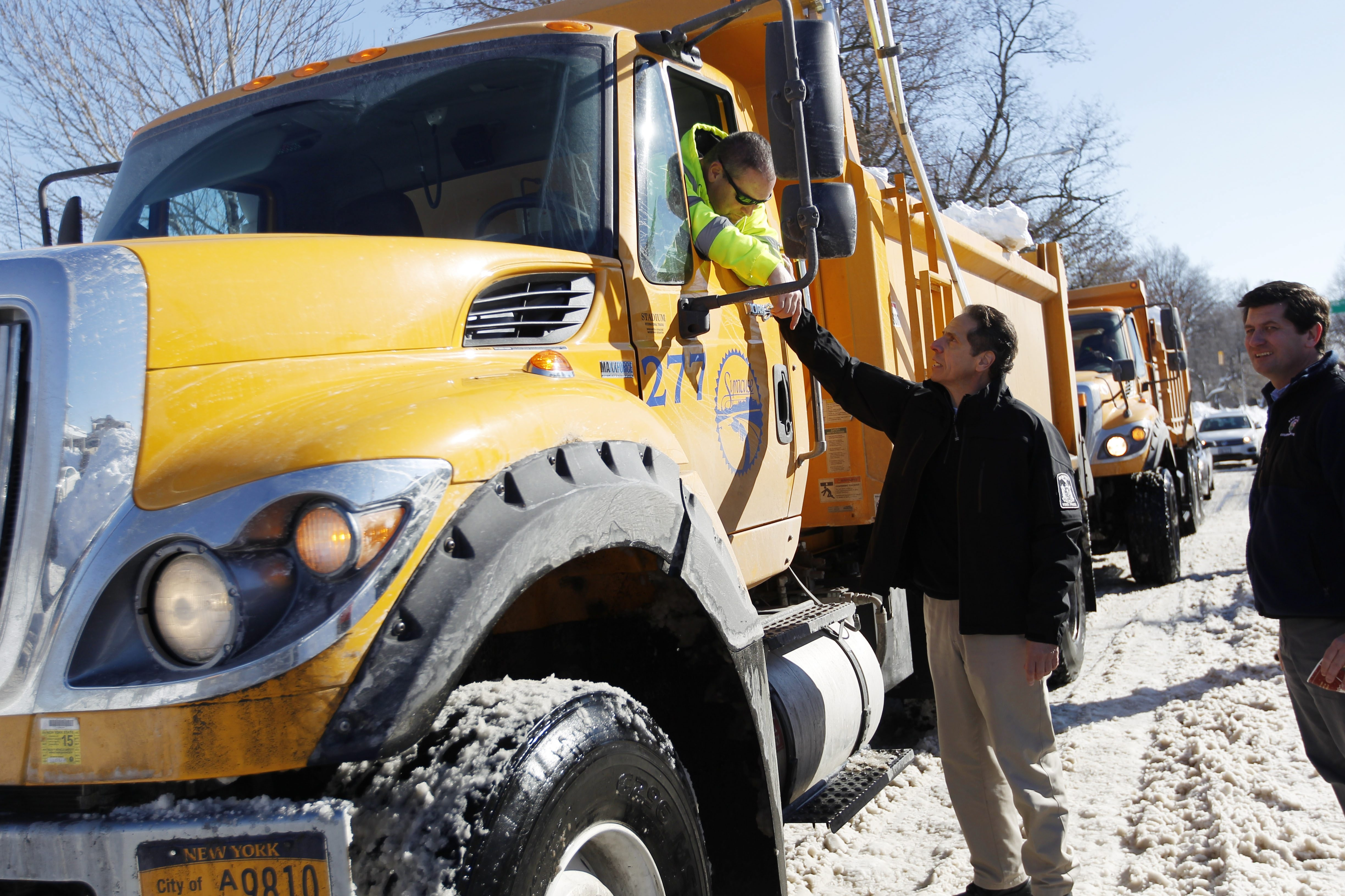 Gov. Andew M. Cuomo thanks a DOT truck driver transporting snow outside Mercy Hospital. The governor toured parts of South Buffalo and Orchard Park Friday.