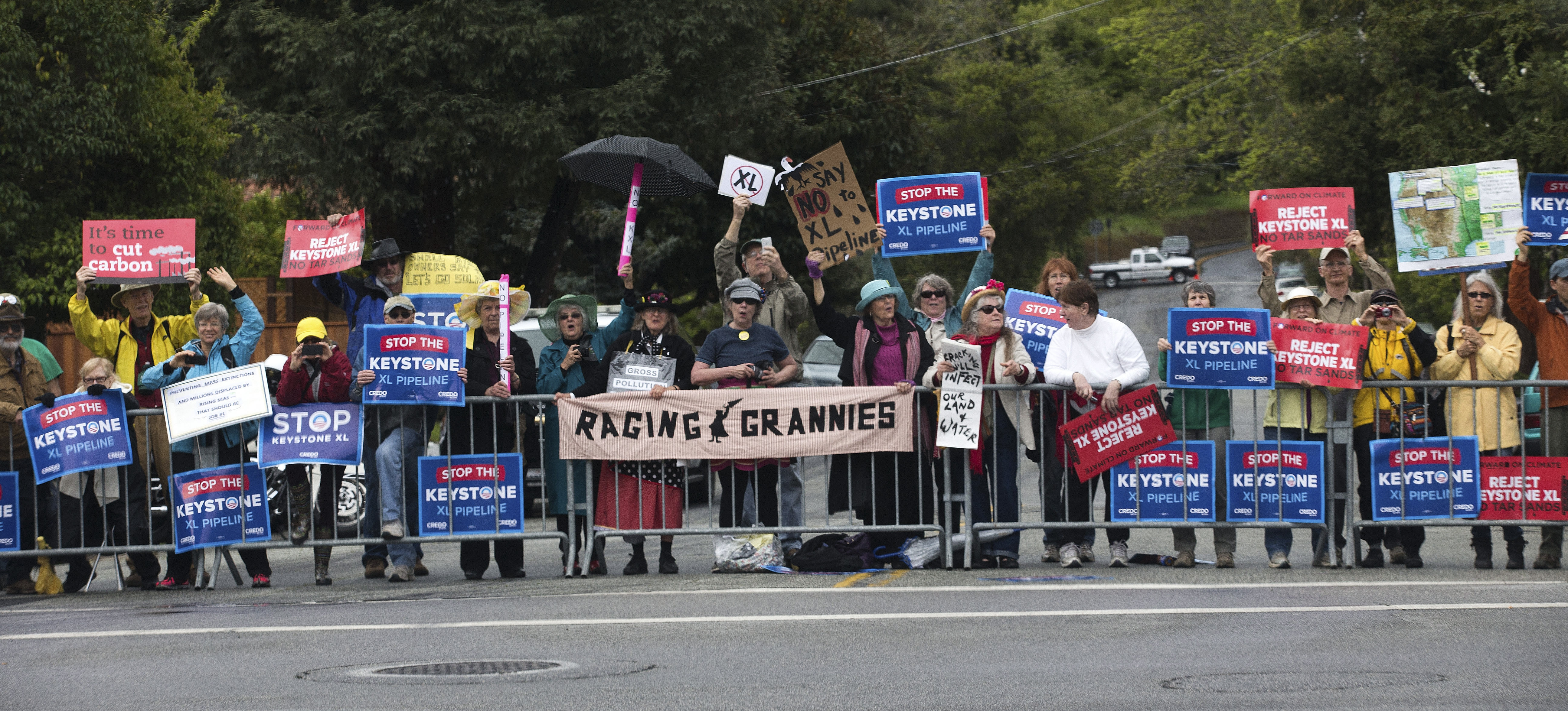 The Keystone XL pipeline has stirred passions on both sides. These pipeline opponents greeted President Obama during his visit to Atherton, Calif., last year.