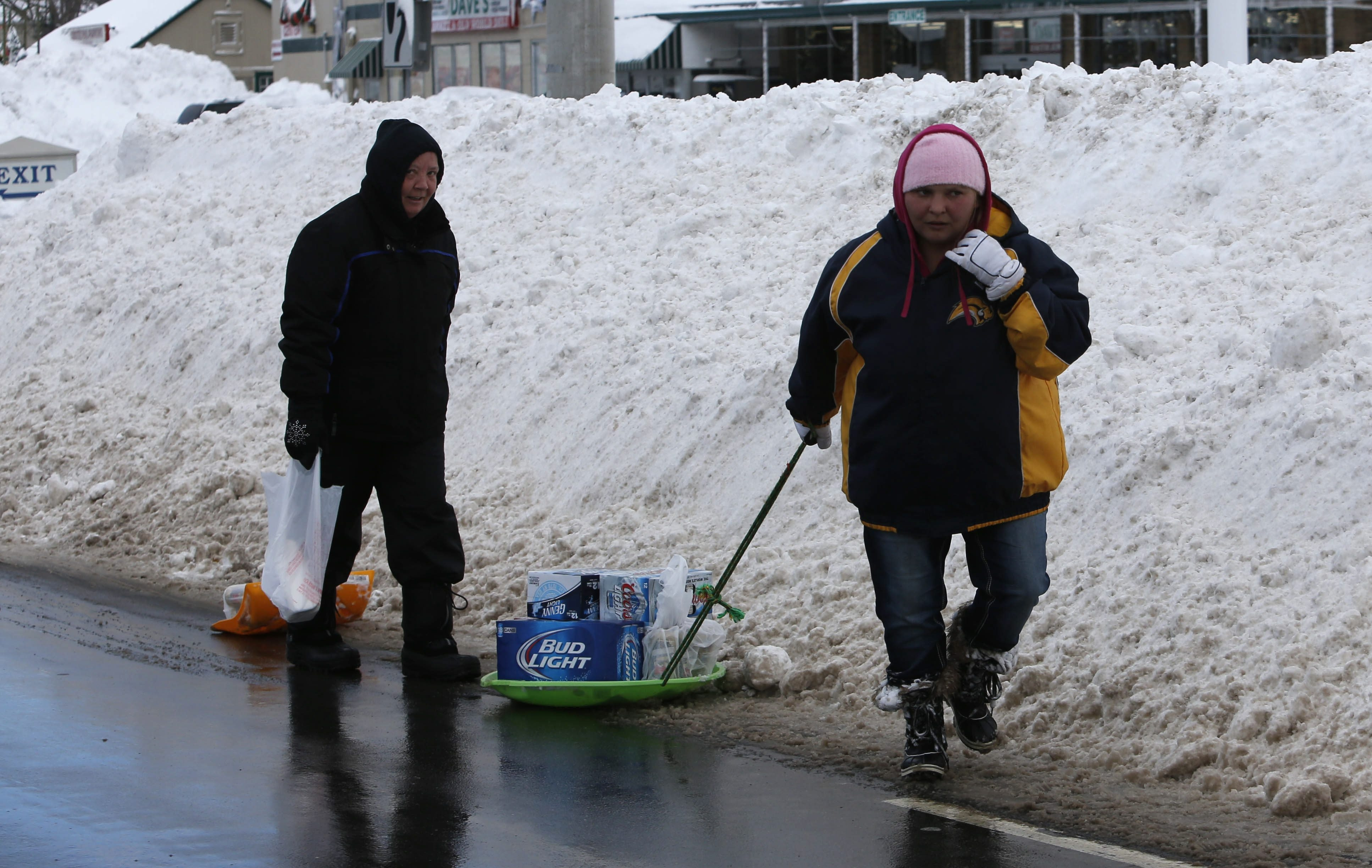 Pedestrians carry supplies down Union Road in Cheektowaga, Thursday, Nov. 20, 2014.  (Derek Gee/Buffalo News)
