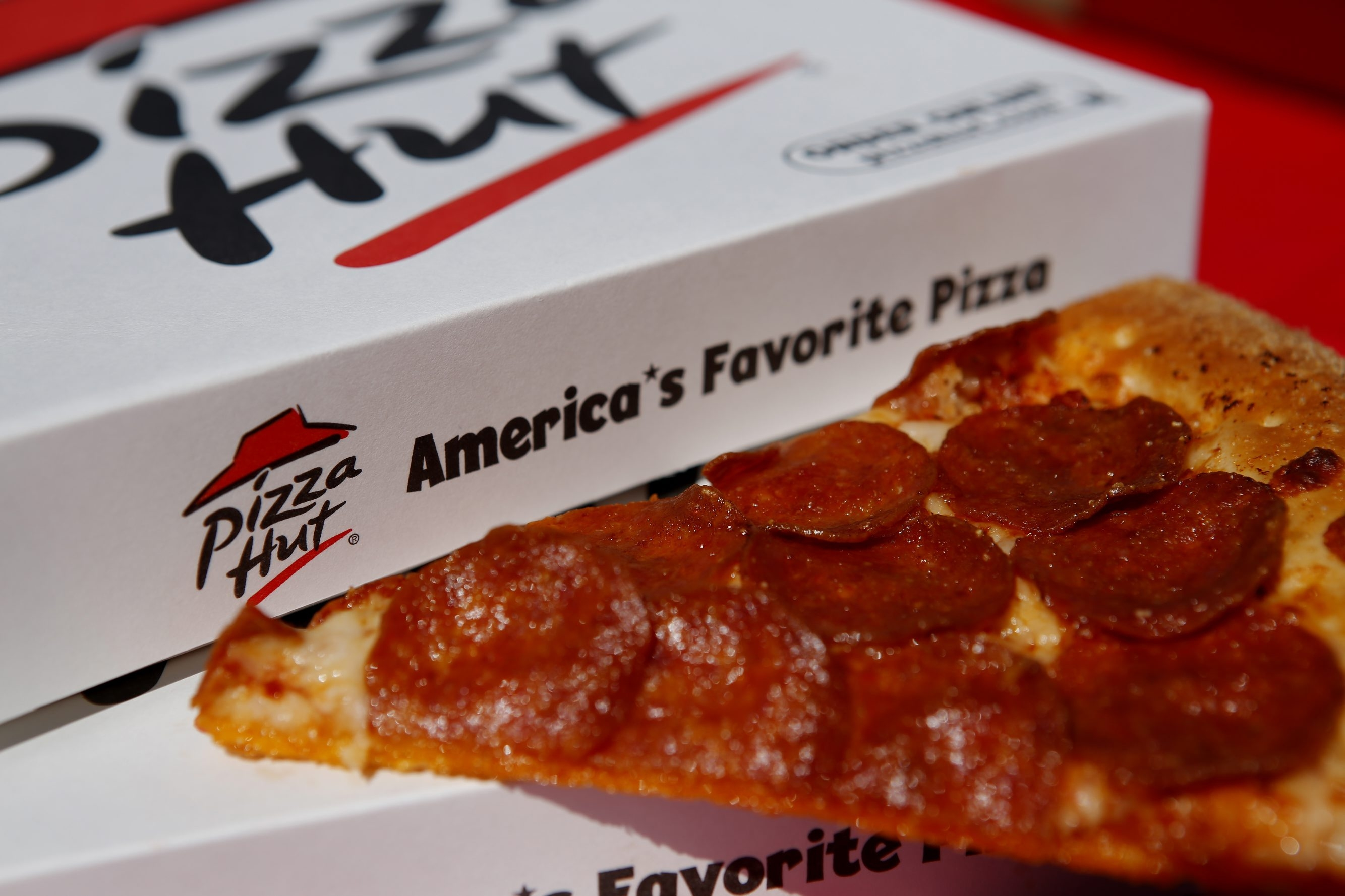 A pepperoni pizza from a Pizza Hut restaurant, a unit of Yum! Brands Inc., is arranged for a photograph in Torrance, California, U.S., on Monday, Oct. 7, 2013. Yum! Brands Inc. is scheduled to release earnings data on Oct. 8. Photographer: Patrick T. Fallon/Bloomberg