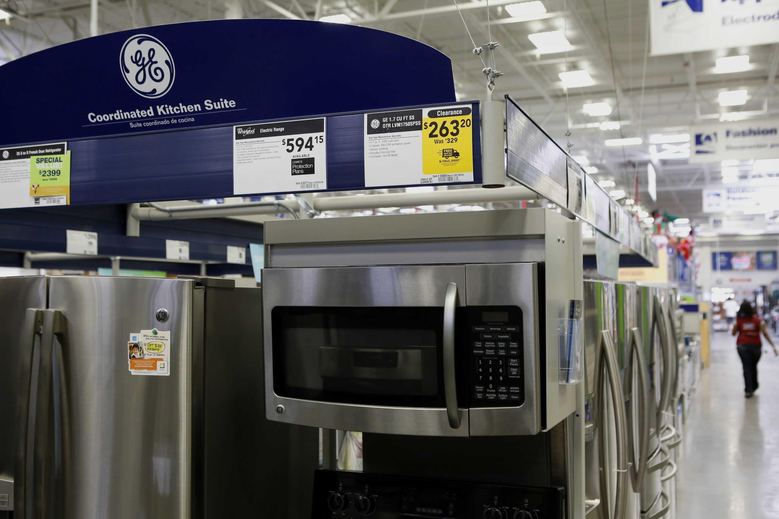 A General Electric refrigerator and microwave oven are on display on the sales floor at Lowe's, which attributes its third-quarter surge to customers' having more confidence about the value of their homes.