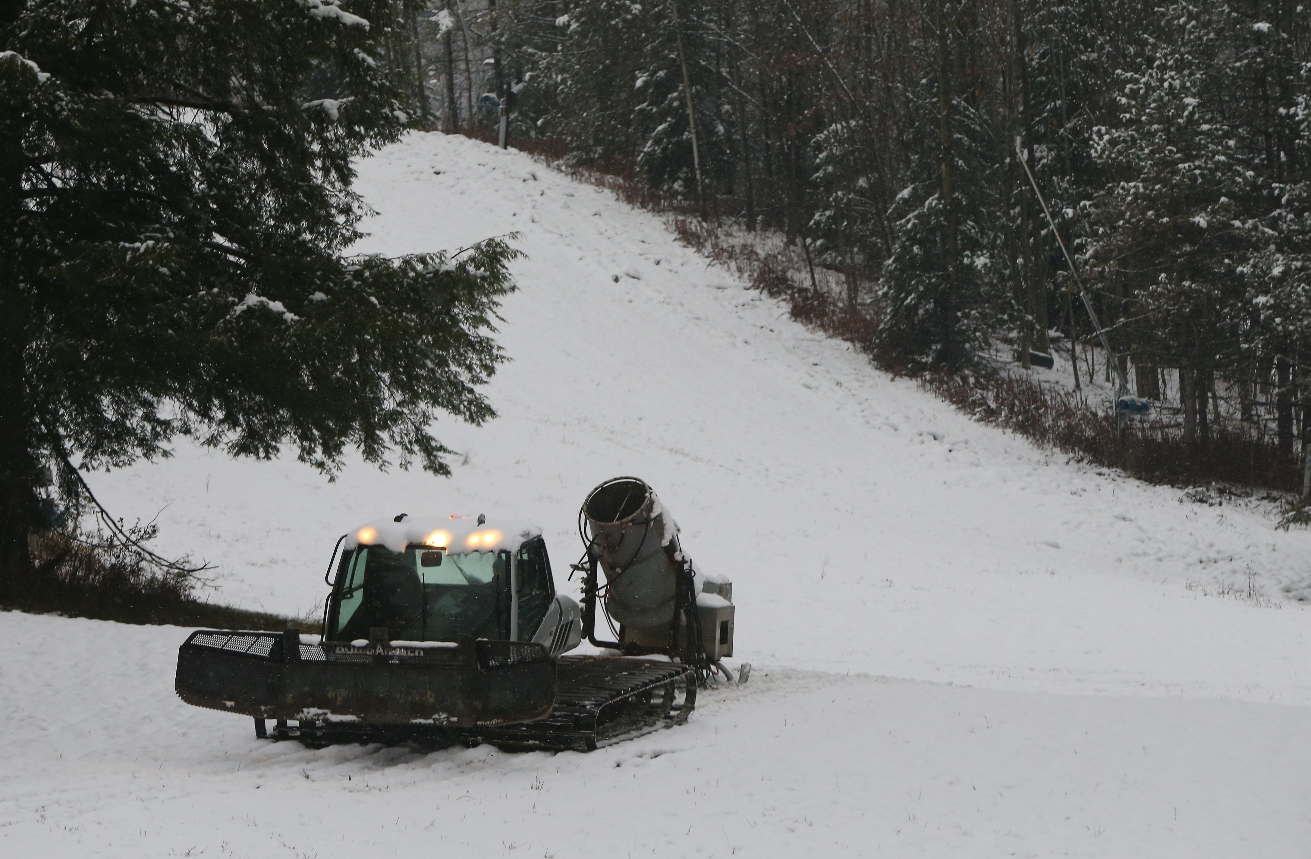 In a photo taken Monday before the snowstorm, crews at Kissing Bridge in Glenwood move snow-making equipment into place. A spokeswoman said that despite getting 12 inches of snow so far this week, the resort still plans to open for the season Nov. 28.