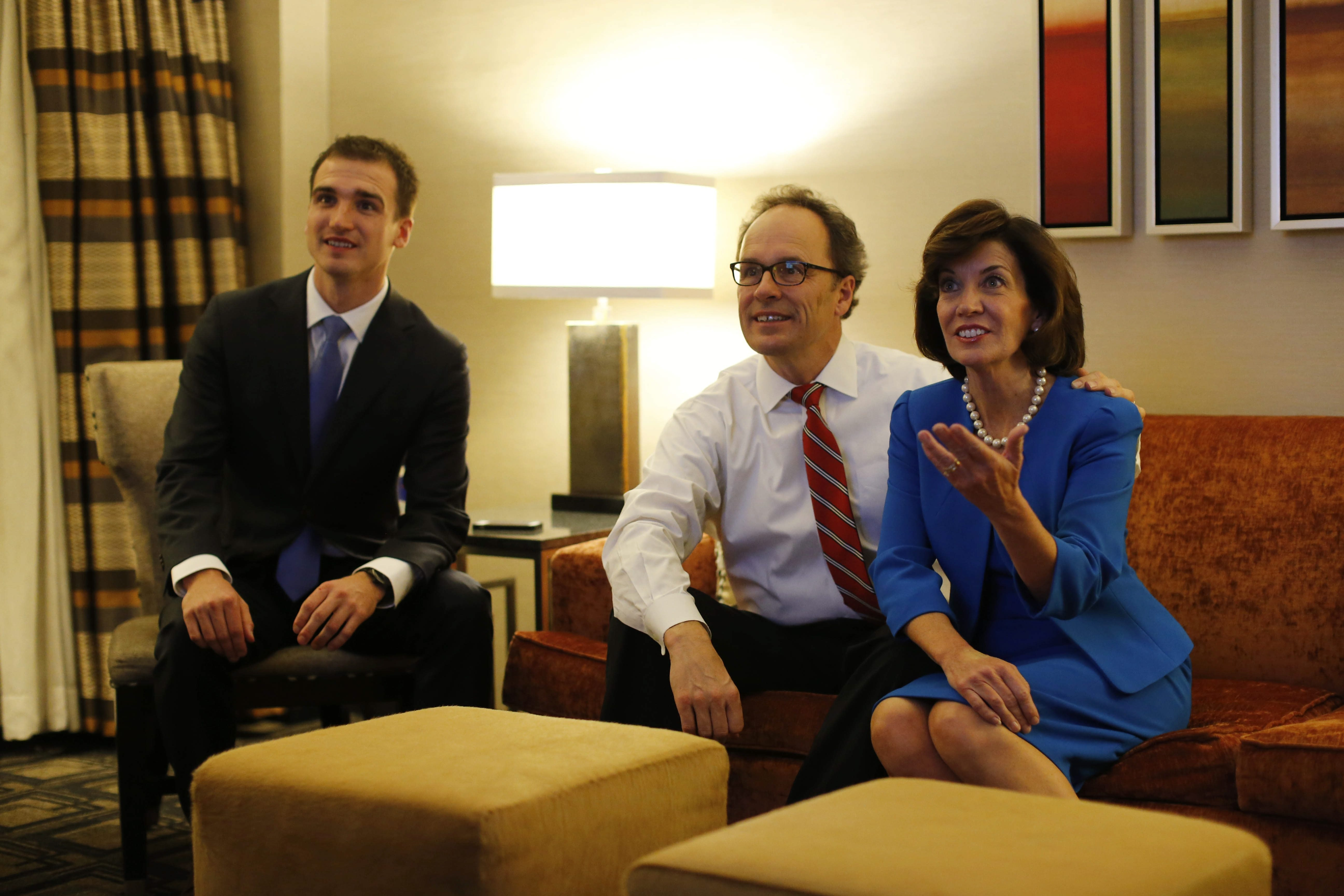 Kathy Hochul watches election returns come in with her husband, U.S. Attorney William Hochul, and their son Will in a room at the Sheraton New York Times Square.