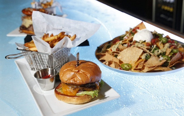 The burger and nachos from (716) on the bar-top that resembles a slab of ice. Don't worry, it won't chill your food. (Derek Gee / Buffalo News)