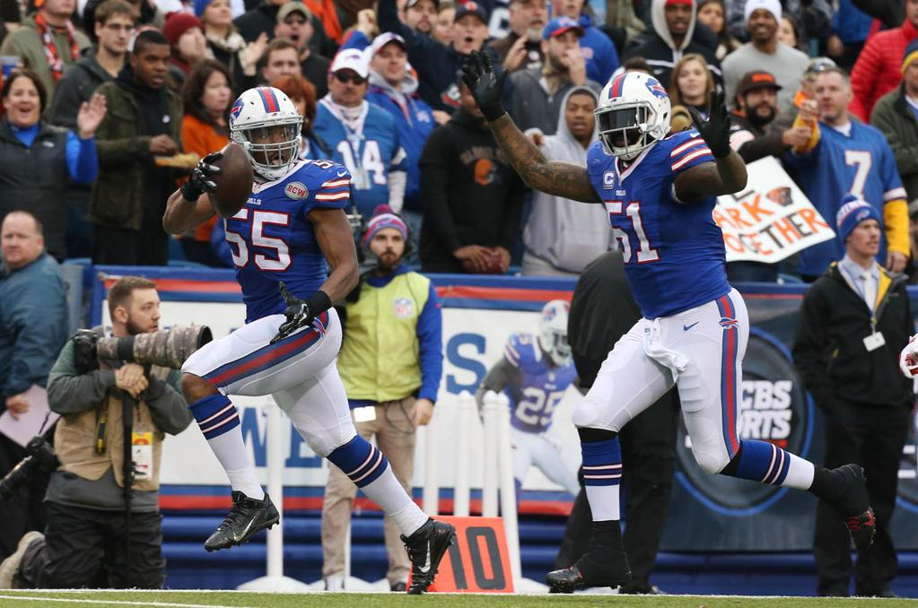 Jerry Hughes returns a fumble that he forced for an 18-yard touchdown in the third quarter. (James P. McCoy/Buffalo News)