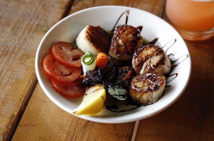 The sea scallops with sun- dried tomato and pesto. (Sharon Cantillon/Buffalo News)