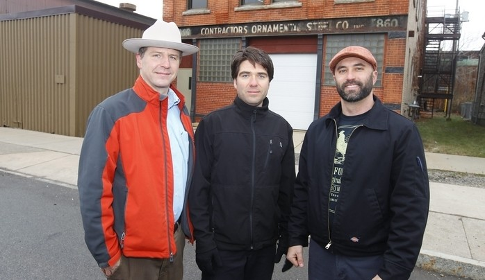 Owners Andy Wegrzyn, left, Eric Kempisty and Frank Weber stand outside Buffalo Distilling Co. on Seneca Street Wednesday. (John Hickey/Buffalo News)