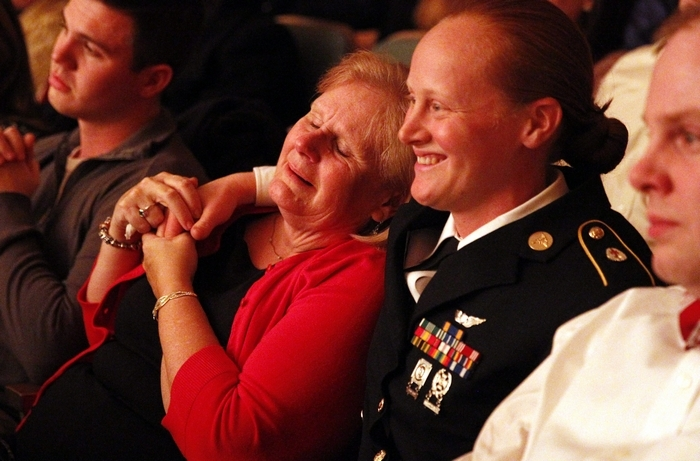 Mary Beth Bauman-Moyer and daughter Army Sgt. Katie Bauman enjoy the BPO Holiday Pops concert after their surprise reunion Saturday night. Sgt. Bauman, serving in Afghanistan for the last four years, is now stationed in Alaska. (Sharon Cantillon/Buffalo News)