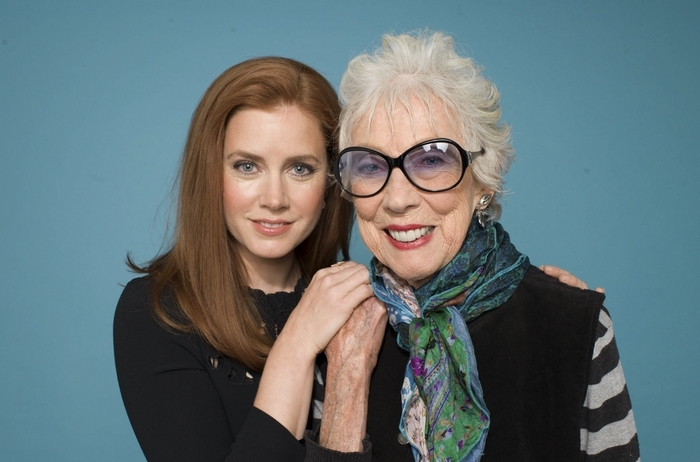 "Amy Adams, left, is photographed with the artist Margaret Keane, whom she plays in the film ""Big Eyes,"" directed by Tim Burton. The rise of the Keane aesthetic in the '60s, and the gradual and extravagant unraveling of her and her husband Walter Keane's lie, nearly two decades later, is the subject of Burton's new biopic, opening Thursday. (Sam Comen/New York Times)"
