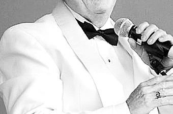 Paul Ferington is conducting on Christmas Eve in Williamsville United Methodist Church.