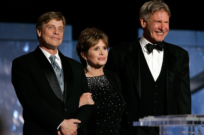 """Actors Mark Hamill, left, Carrie Fisher and Harrison Ford return in """"Star Wars: The Force Awakens,"""" which is set for a December 2015 release. (Getty Images)"""