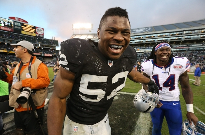 Raiders linebacker Khalil Mack has a laugh with Bills receiver Sammy Watkins  after Sunday's game. (James P. McCoy/Buffalo News)