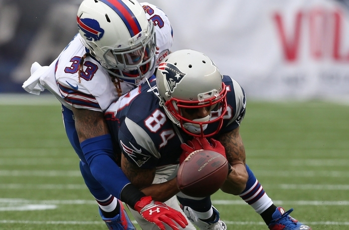 Bills cornerback Ron Brooks plays tight on Patriots wide receiver Brian Tyms in the second quarter. (James P. McCoy/Buffalo News)