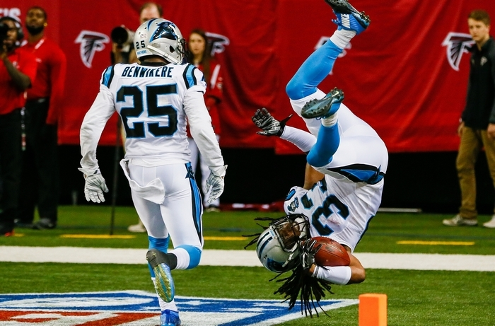 Tre Boston of the Carolina Panthers goes airborne while celebrating an interception return for a touchdown in the second half against the Falcons. (Getty Images)