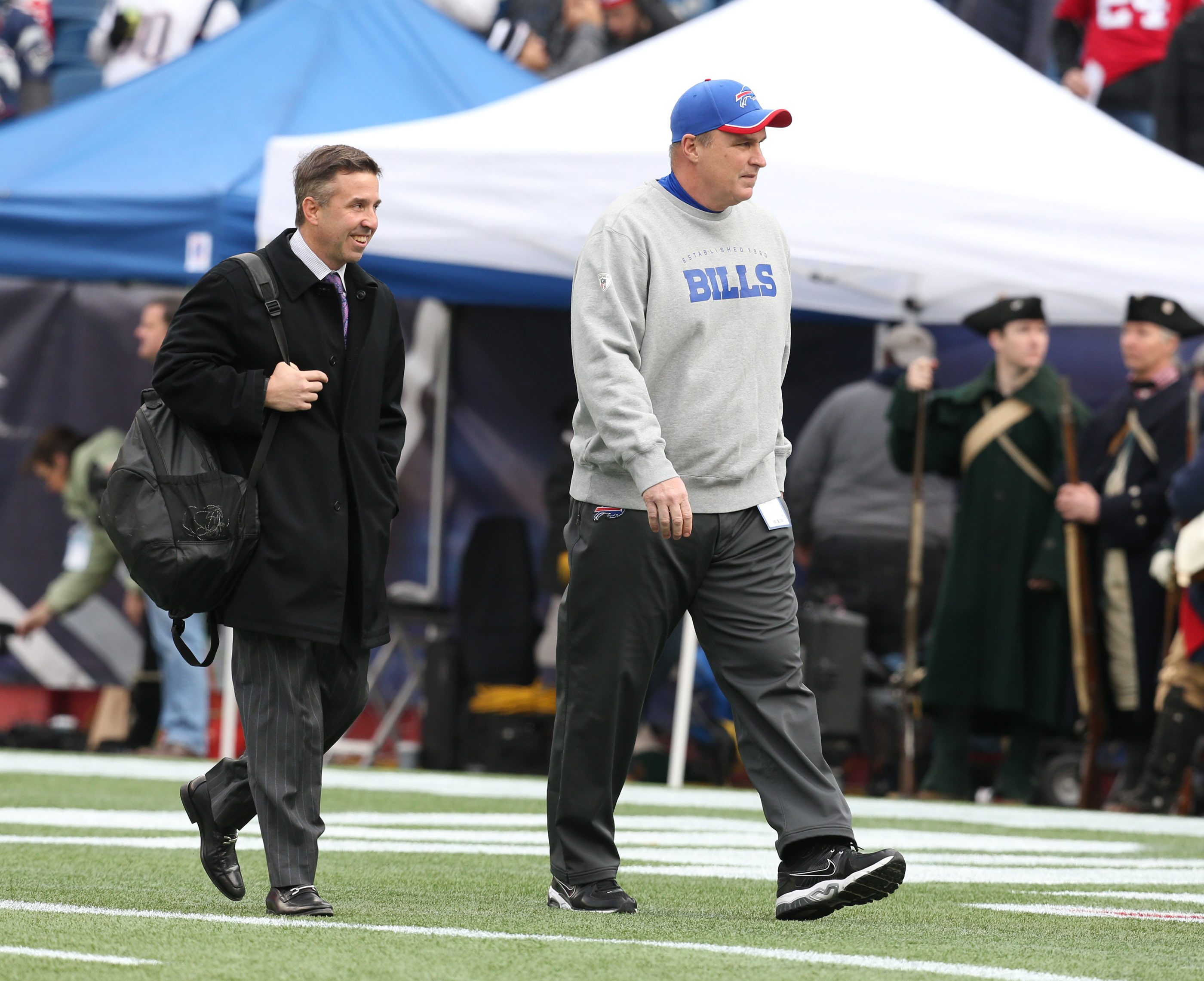 Buffalo Bills head coach Doug Marrone (right) and Russ Brandon walk onto the field prior to today's game.  (James P. McCoy/Buffalo News)