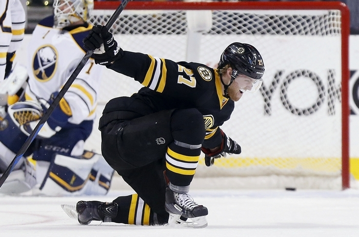 Boston's Dougie Hamilton celebrates his power-play goal in the first period that snapped the Bruins' 0-for-11 man-advantage skid. (Associated Press)