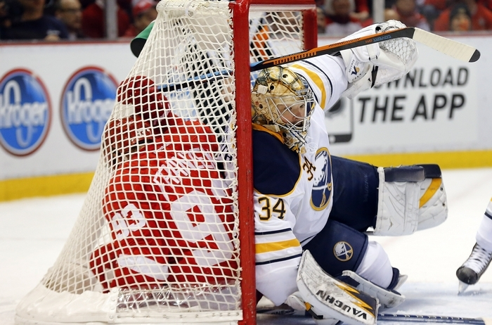 Sabres goalie Michal Neuvirth shares the net with the Red Wings' Johan Franzen during play in the second period in Detroit. (Associated Press)