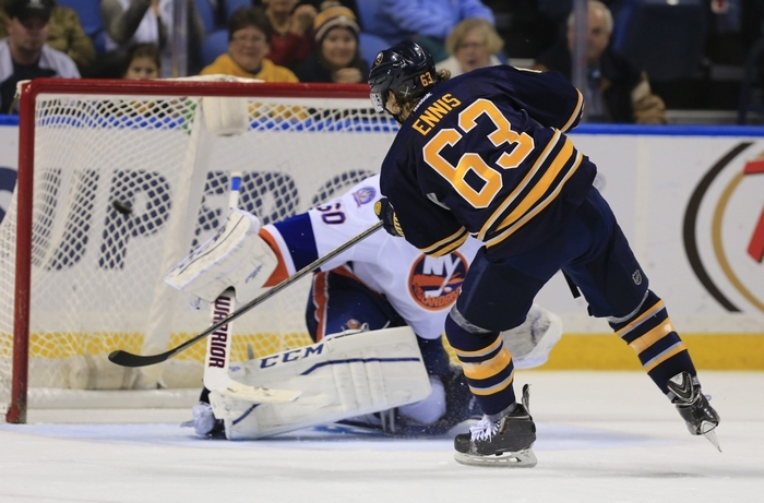Sabres' Tyler Ennis scores the only goal in the shootout against Islanders goaltender Kevin Poulin to give Buffalo a come-from-behind win. (Harry Scull Jr./Buffalo News)