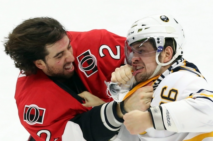 The Sabres' Patrick Kaleta, right, survived this fight with Ottawa's Jared Cowan and a scary crash into the boards that forced him from Monday's game. Kaleta is expected to play Wednesday night against Tampa Bay. (AP Photo/The Canadian Press, Fred Chartrand)