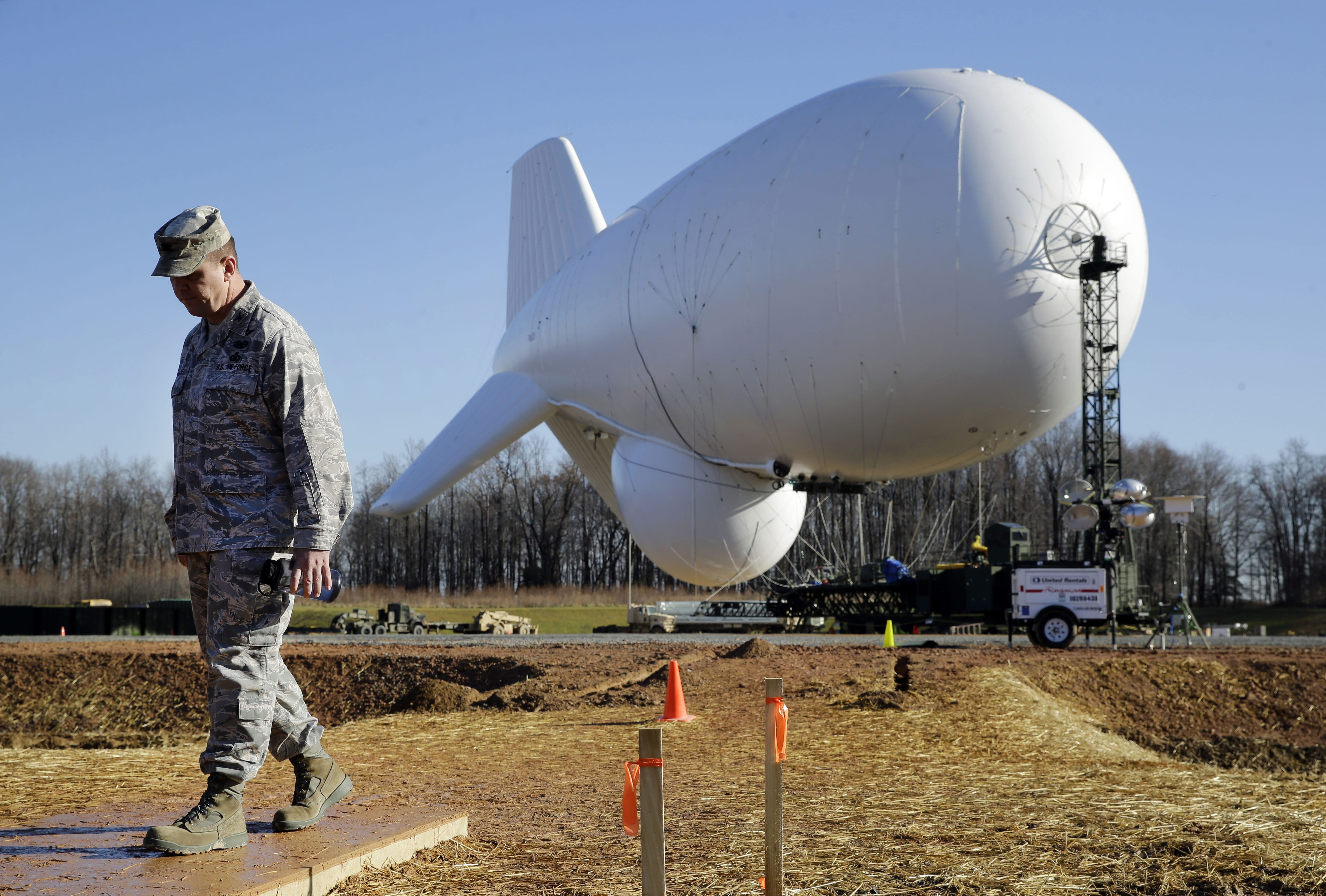 NORAD's Air Force Col. Chuck Douglass walks in front of an unmanned aerostat that is part of a new U.S. military cruise-missile defense system during a media preview last month in Middle River, Md.