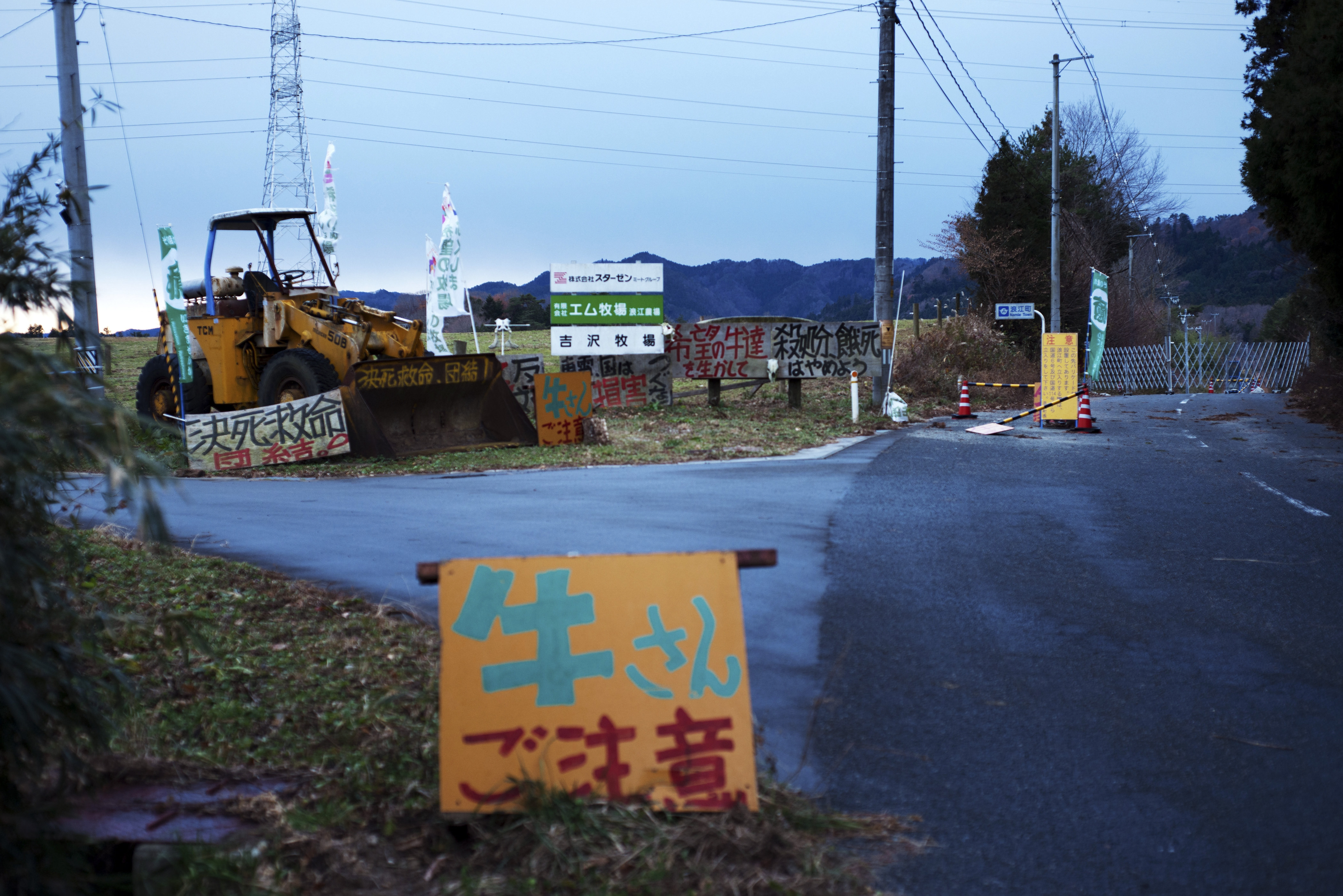 A bulldozer stands at the entrance of a ranch in Namie, Japan, in December 2013. Masami Yoshizawa, a rancher who was angered by what he considers Japan's efforts to sweep away the inconvenient truths of the Fukushima nuclear disaster, says he is even angrier now that Prime Minister Shinzo Abe want so reopen 48 nuclear reactors.