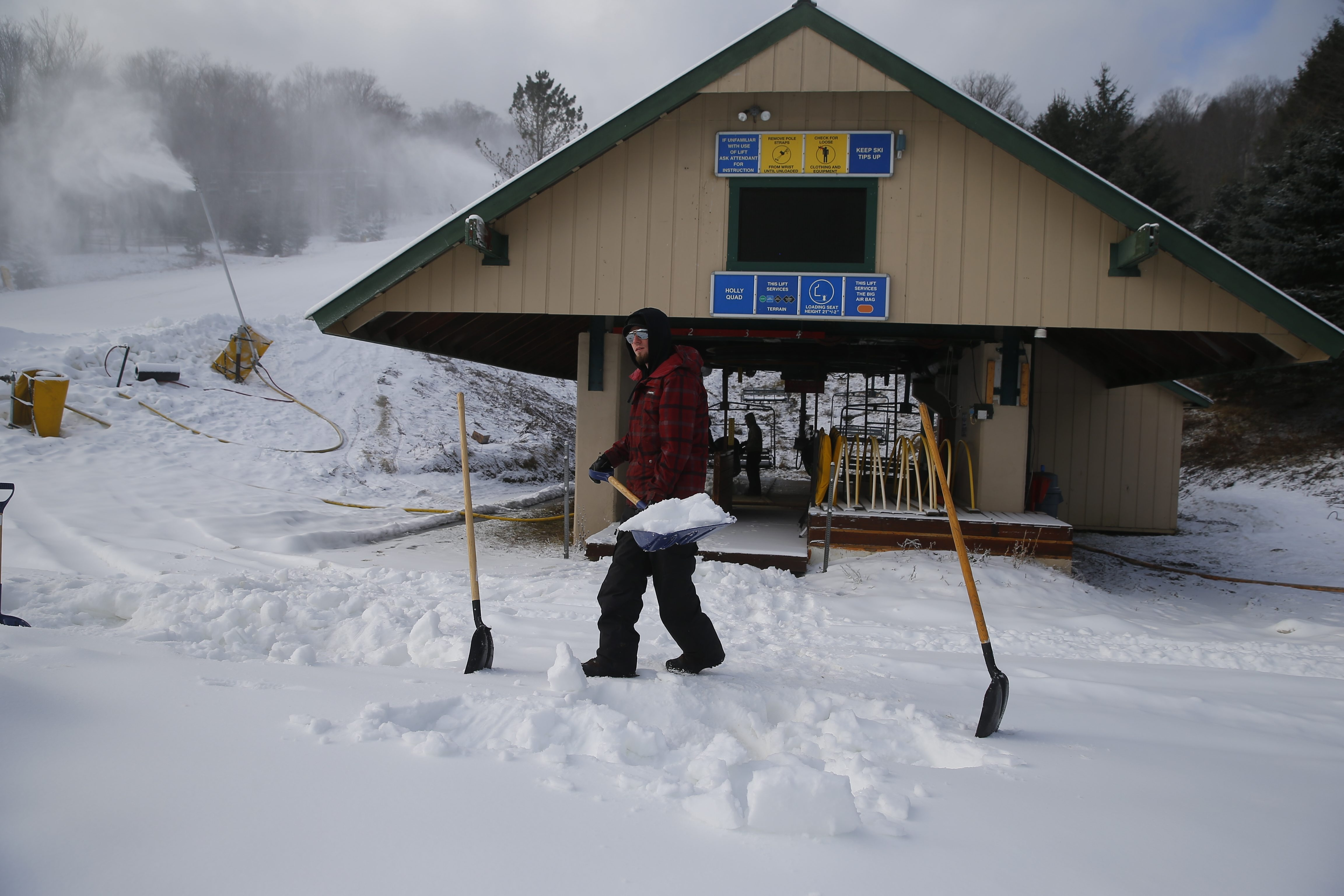 Kyle Anger, a lift attendant at Kissing Bridge in Glenwood, shovels snow at the lift takeoff as the ski resort gets ready for opening day. The forecast for snow and colder temperatures is just what was ordered in Western New York's ski country.