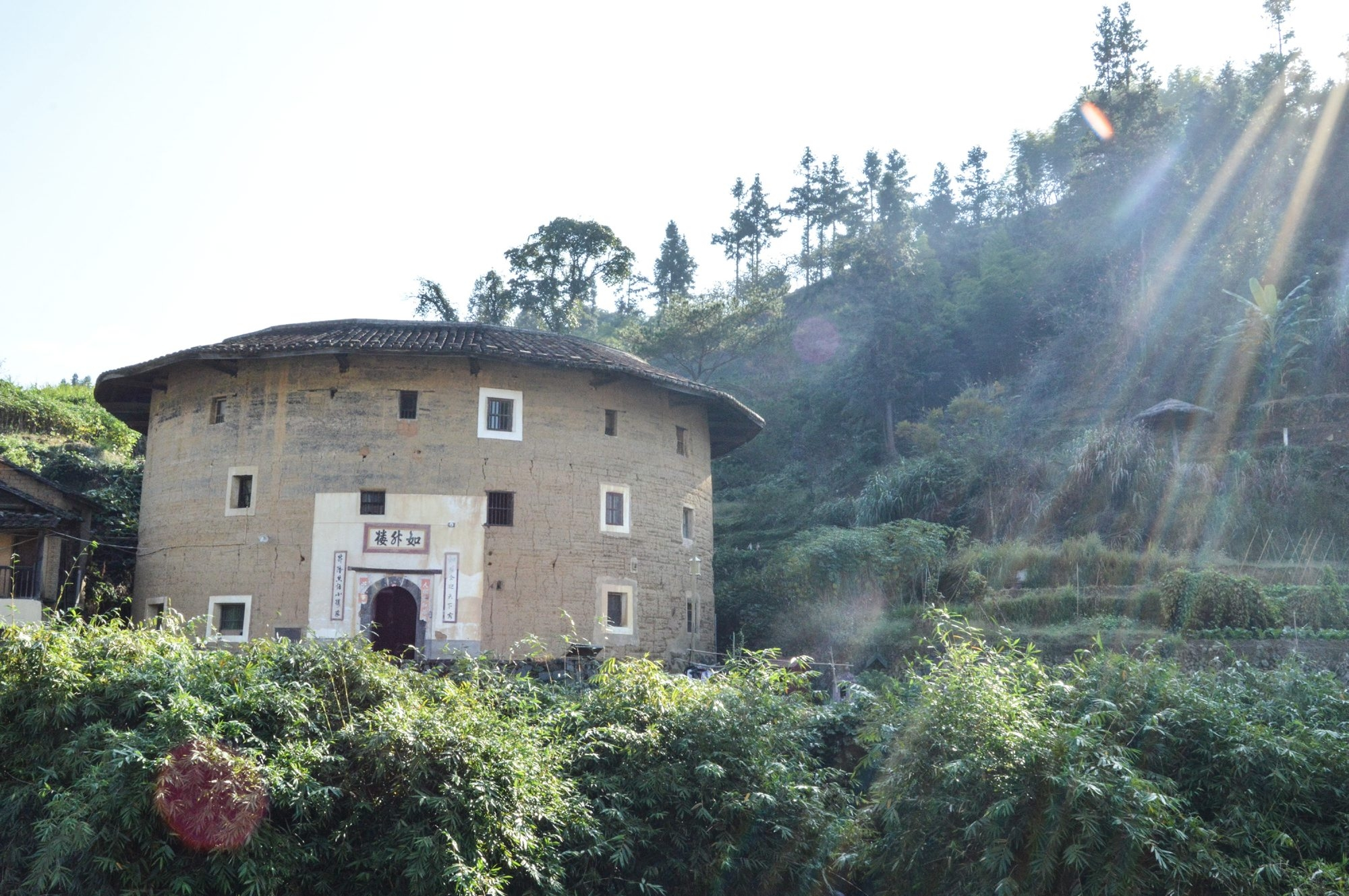 A small tulou sits on a river bank in the village of Hongkeng in rural Fujian province's Yongding county. Academics, preservation groups and residents say the clock is ticking on the ancient fortresses as living, breathing communities