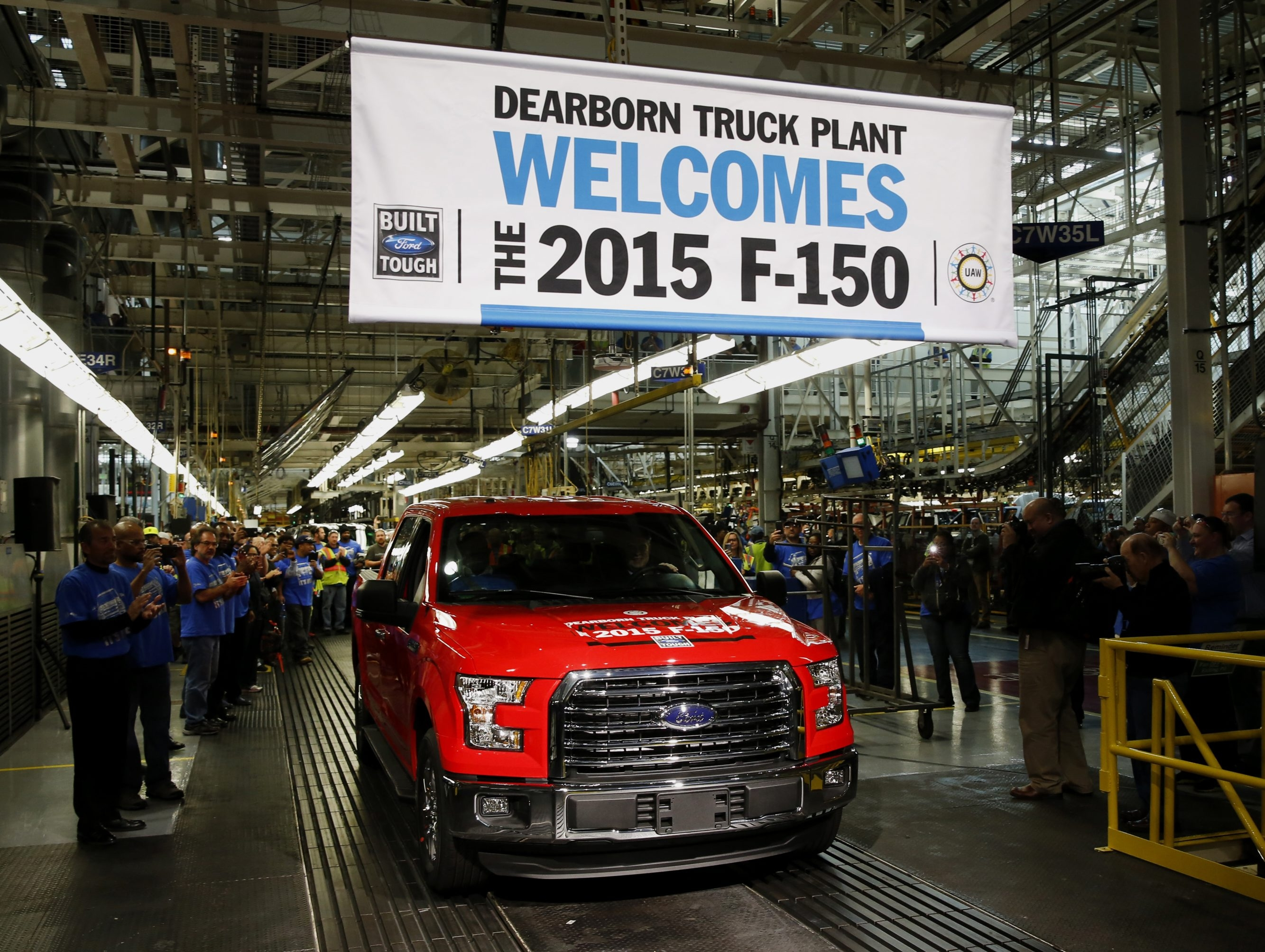 Employees cheer as the first 2015 Ford Motor Co. F-150 truck rolls off the production line during an event at the company's Dearborn truck assembly facility in Dearborn, Mich., in November.