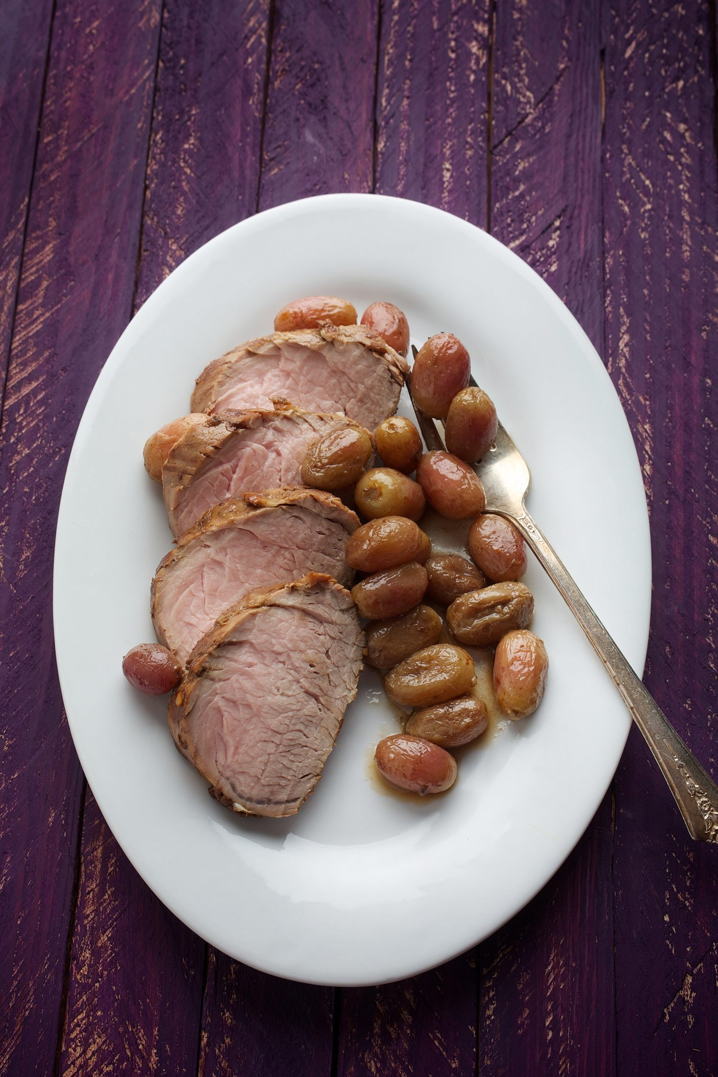 Roasted grapes give a fresh twist to the classic fruit-and-pork pairing.