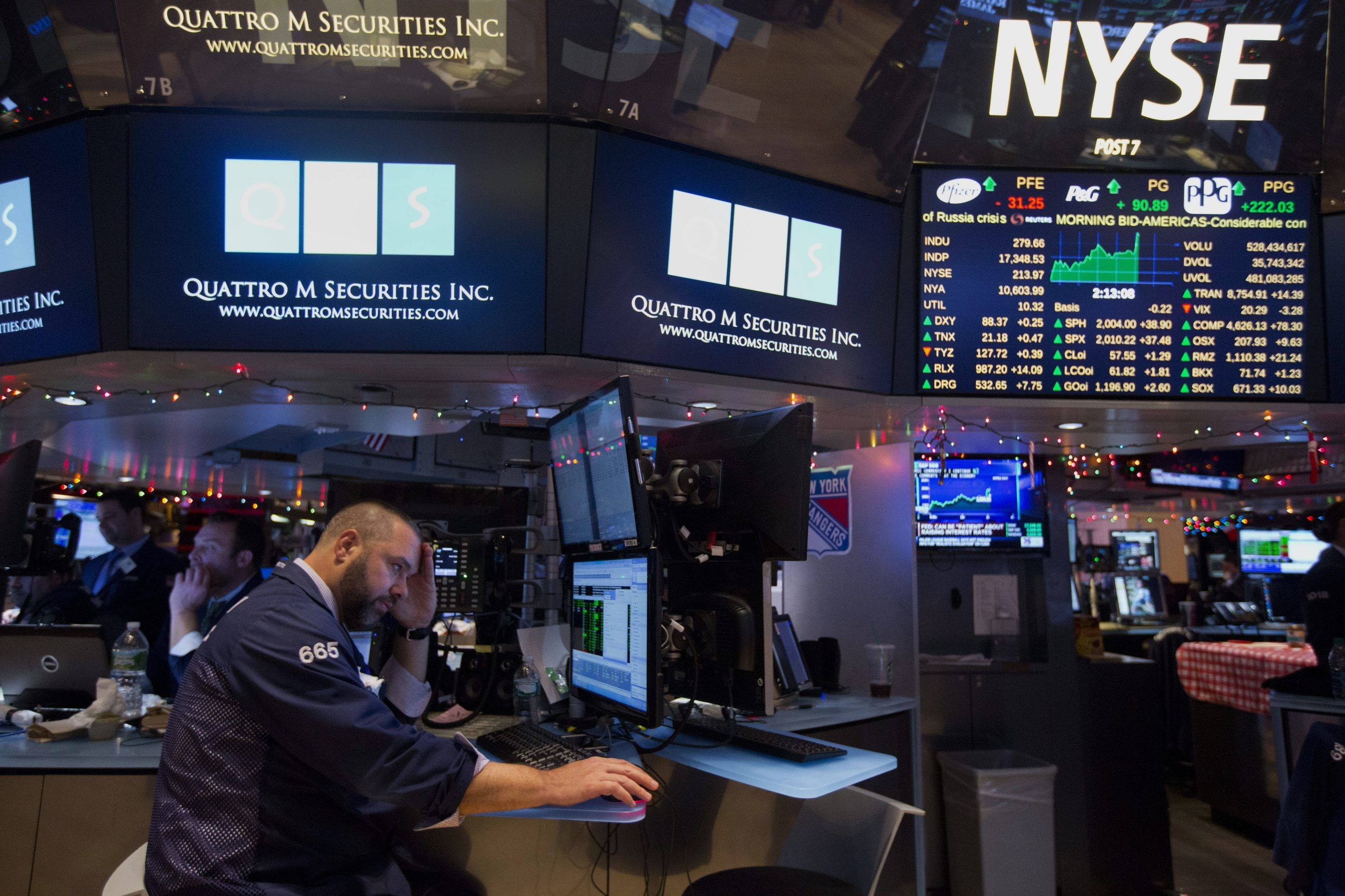 A trader works on the floor of the New York Stock Exchange in New York. Losses in technology stocks such as Microsoft Corp., Intel Corp. and IBM Corp. weighed down the Dow Jones industrial average.