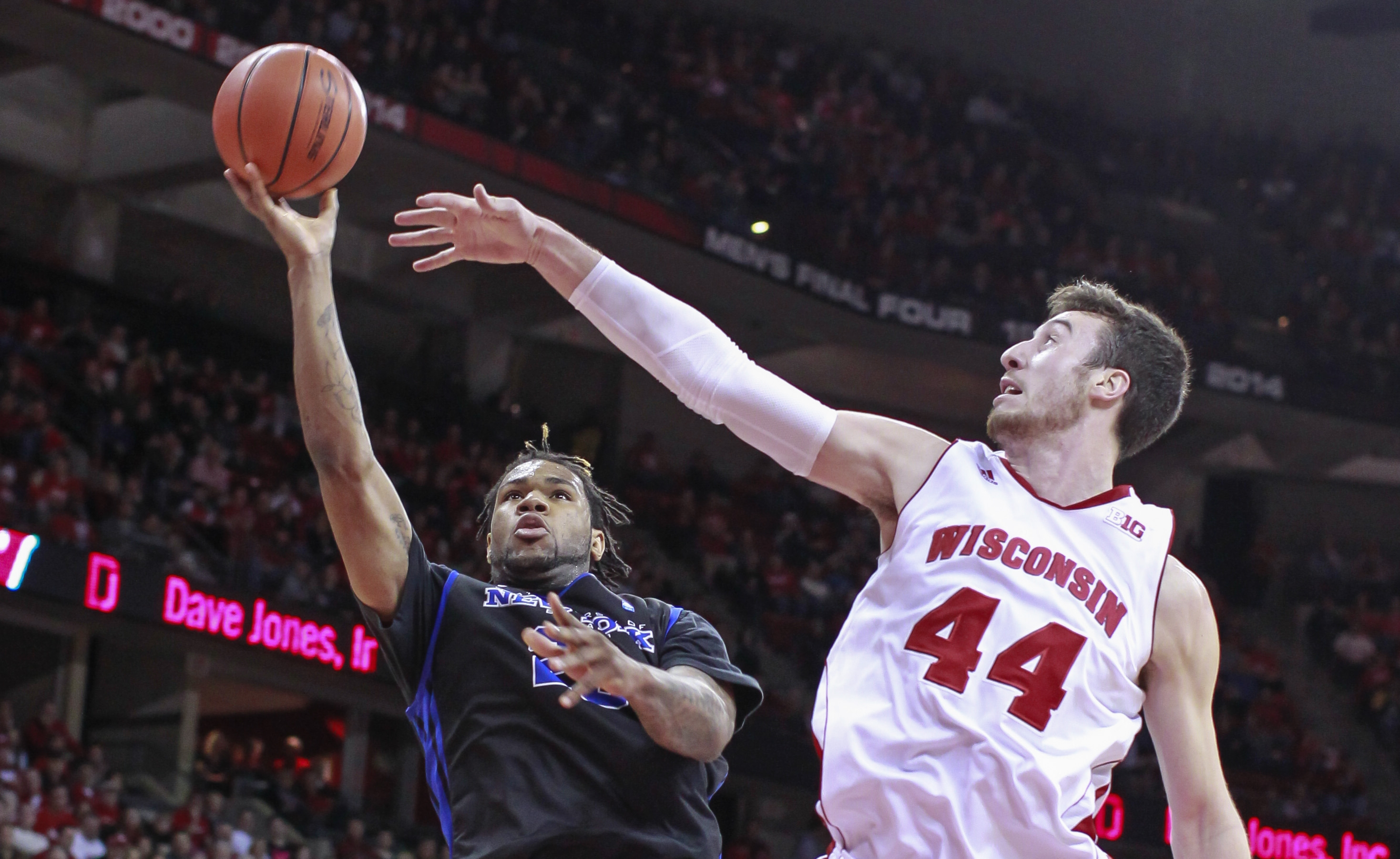 UB's Justin Moss gets off a shot against Wisconsin 7-footer Frank Kaminsky during the first half. Moss led the Bulls with 14 points and 12 rebounds in a 68-56 loss.