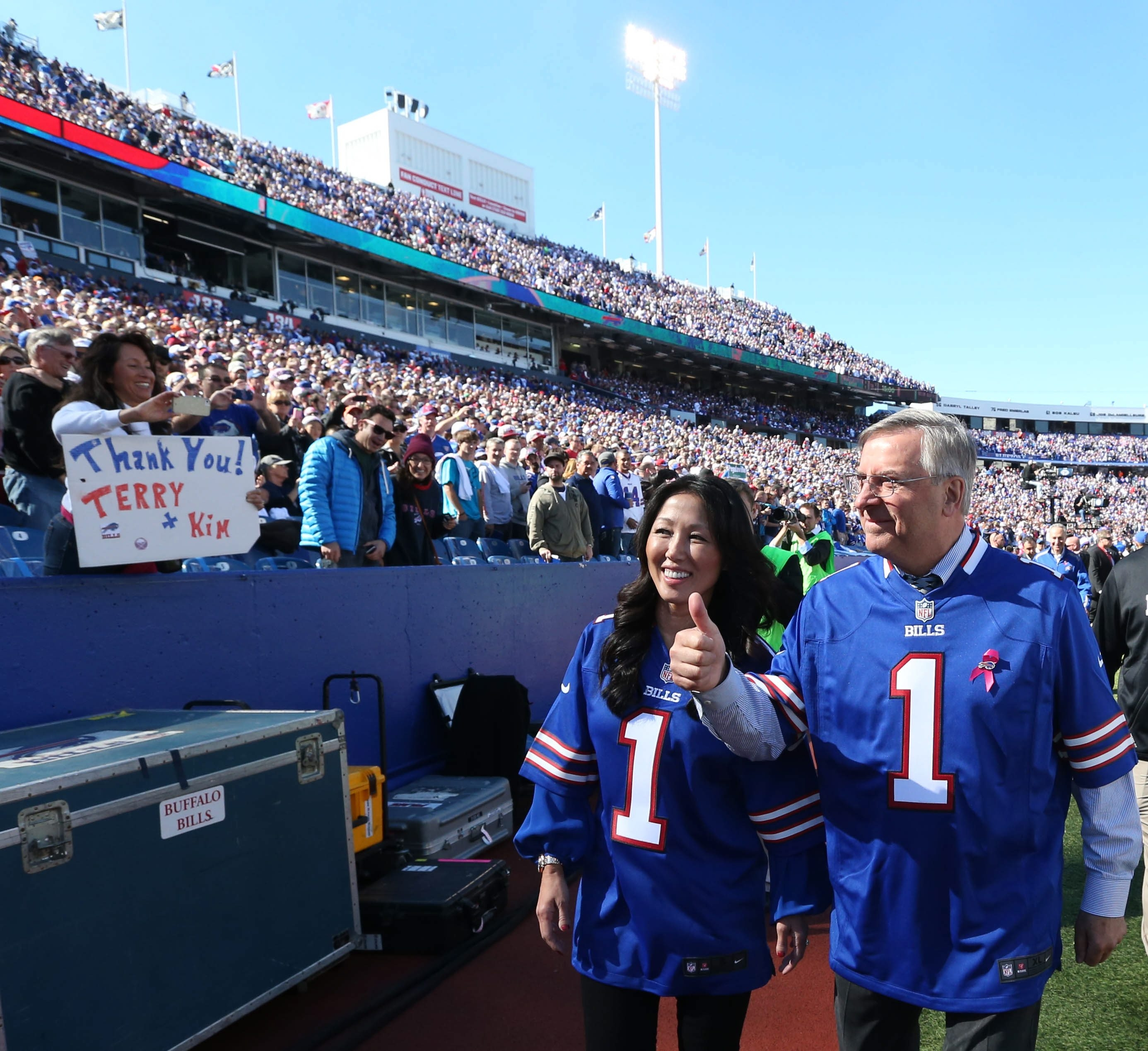 No. 1 couple with Bills fans: New Buffalo Bills owners Kim and Terry Pegula work the crowd after the pre-game ceremony before the game against the New England Patriots at Ralph Wilson Stadium in Orchard Park on Oct. 12, 2014.