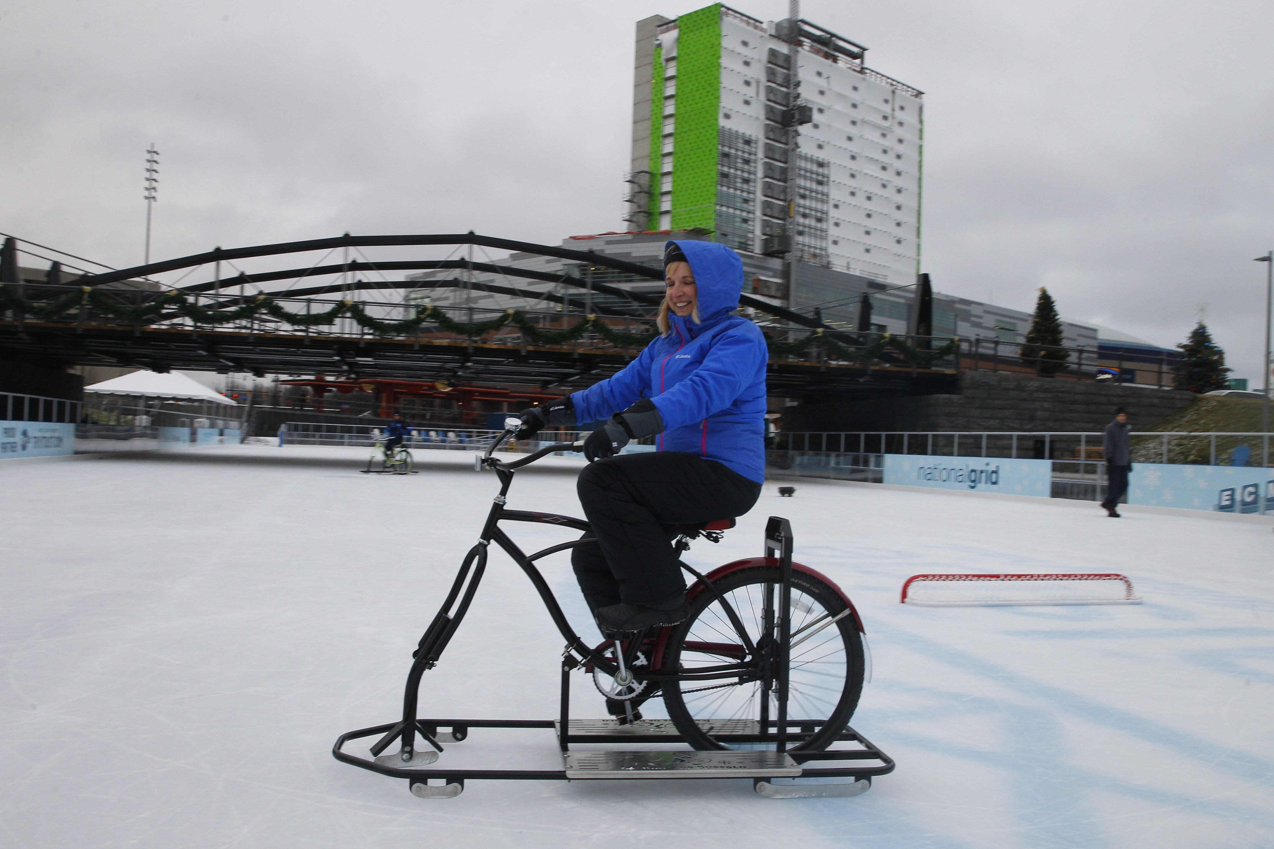 3 lien cut here Lisa Florczak of Ice Bikes demonstrates riding one as preparations underway for tonight's opening of the skating rinks  at Canalside  in Buffalo, N.Y. , on Thursday  December  18, 2014. ()