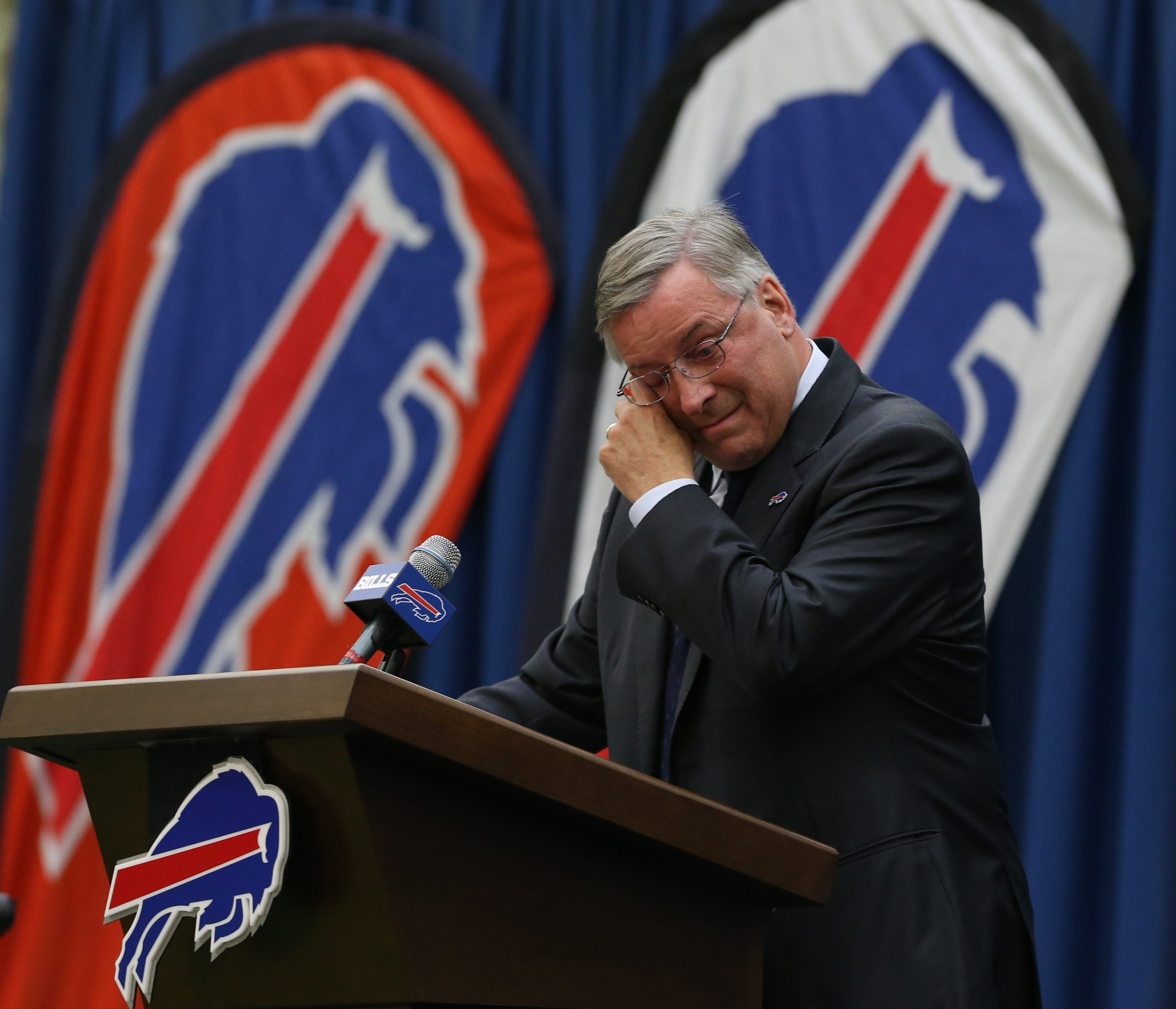 Year of emotions: Terry Pegula cried as he began talking to the press as the newest owner of the Buffalo Bills. A summer highlight had Andre Reed, left, basking in his overdue induction to the Pro Football Hall of Fame. Solomon Renfro, right, and undefeated Canisius High football were nationally ranked in a championship season.