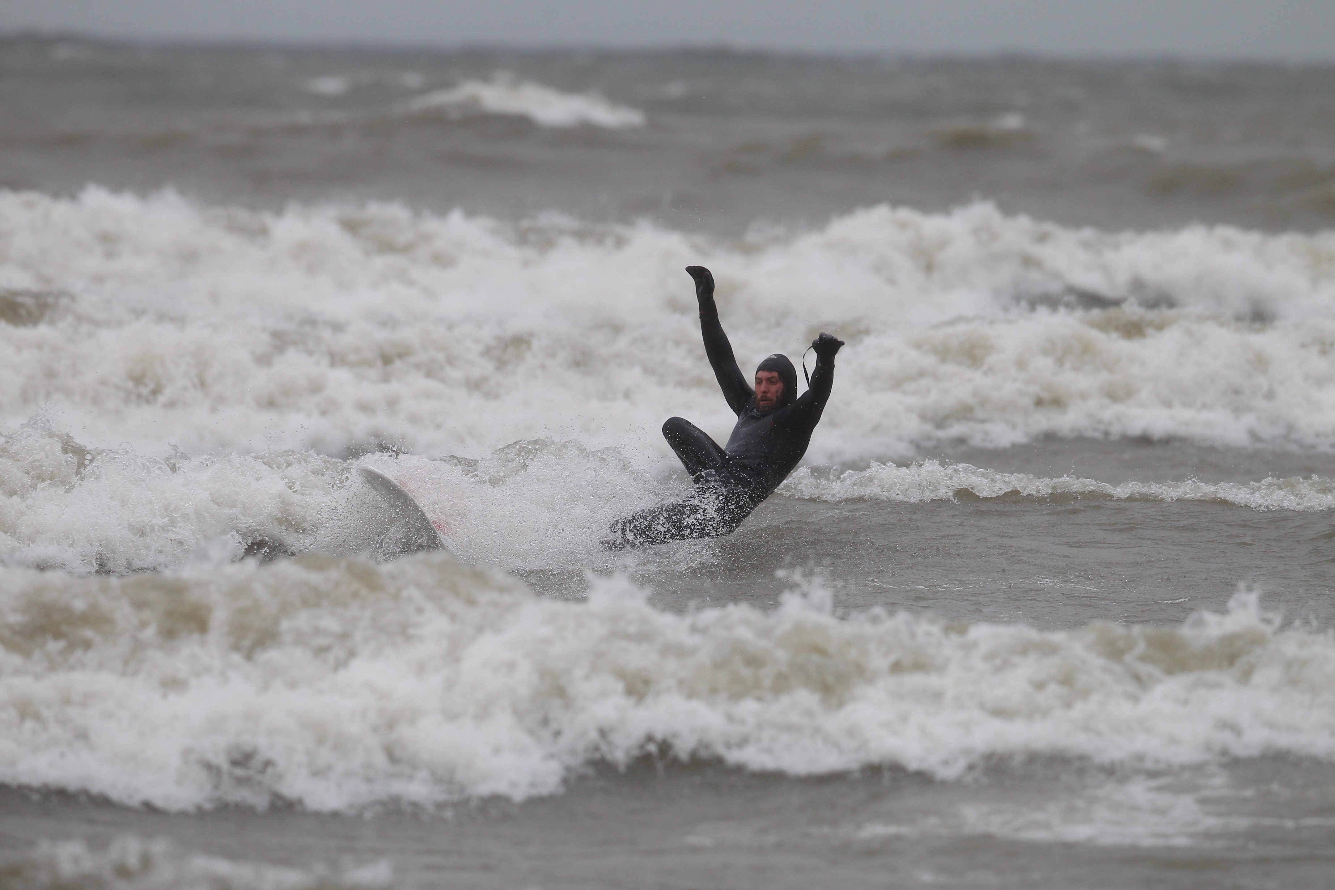 Kevin Cullen comes off his board as he  practices at Sunset Bay Beach in Irving on Dec. 17  for am upcoming  surfing competition.  (John Hickey/Buffalo News)