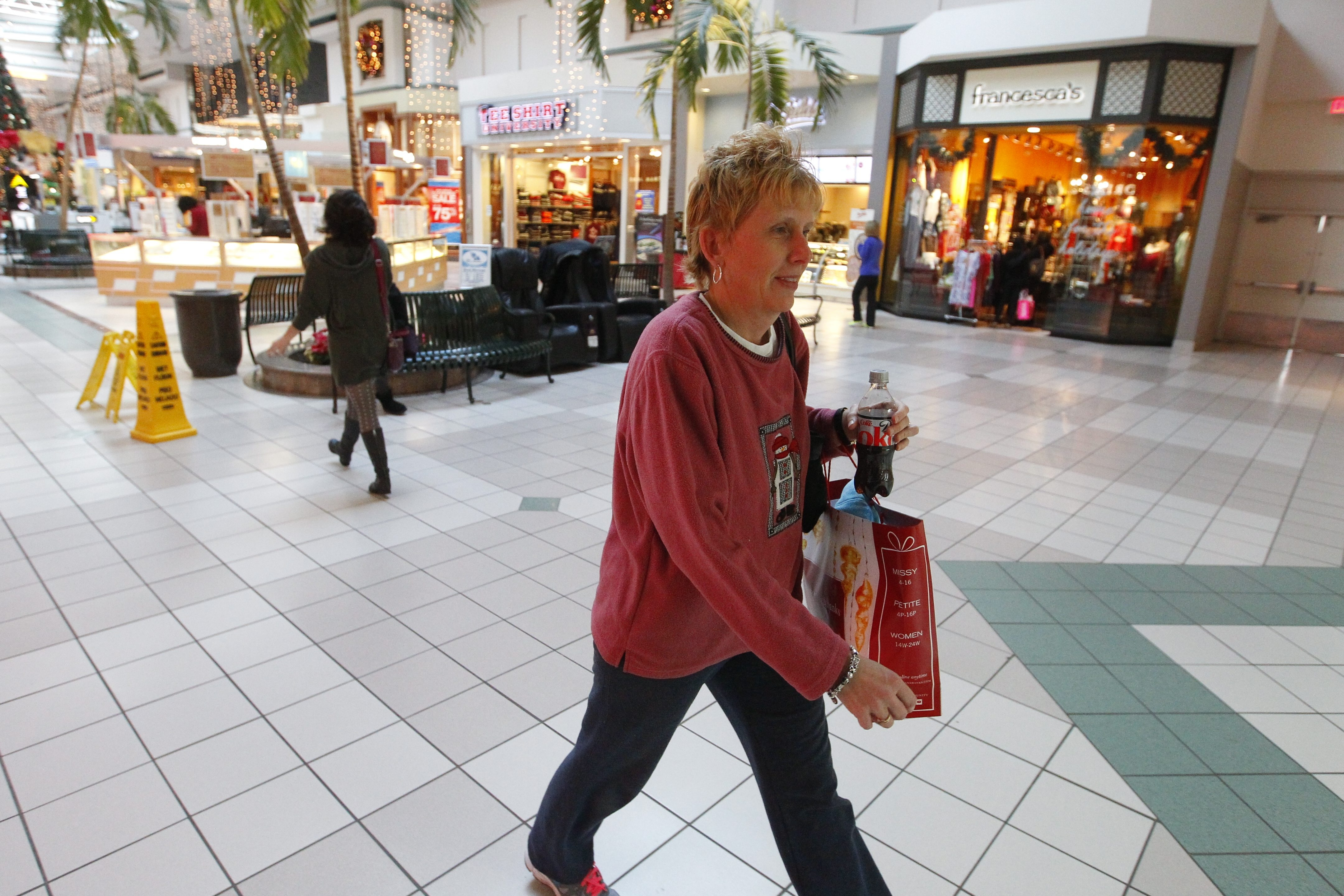Lori Millace returns a item that still had a security tag on it at the Boulevard Mall in Amherst on Dec. 26.