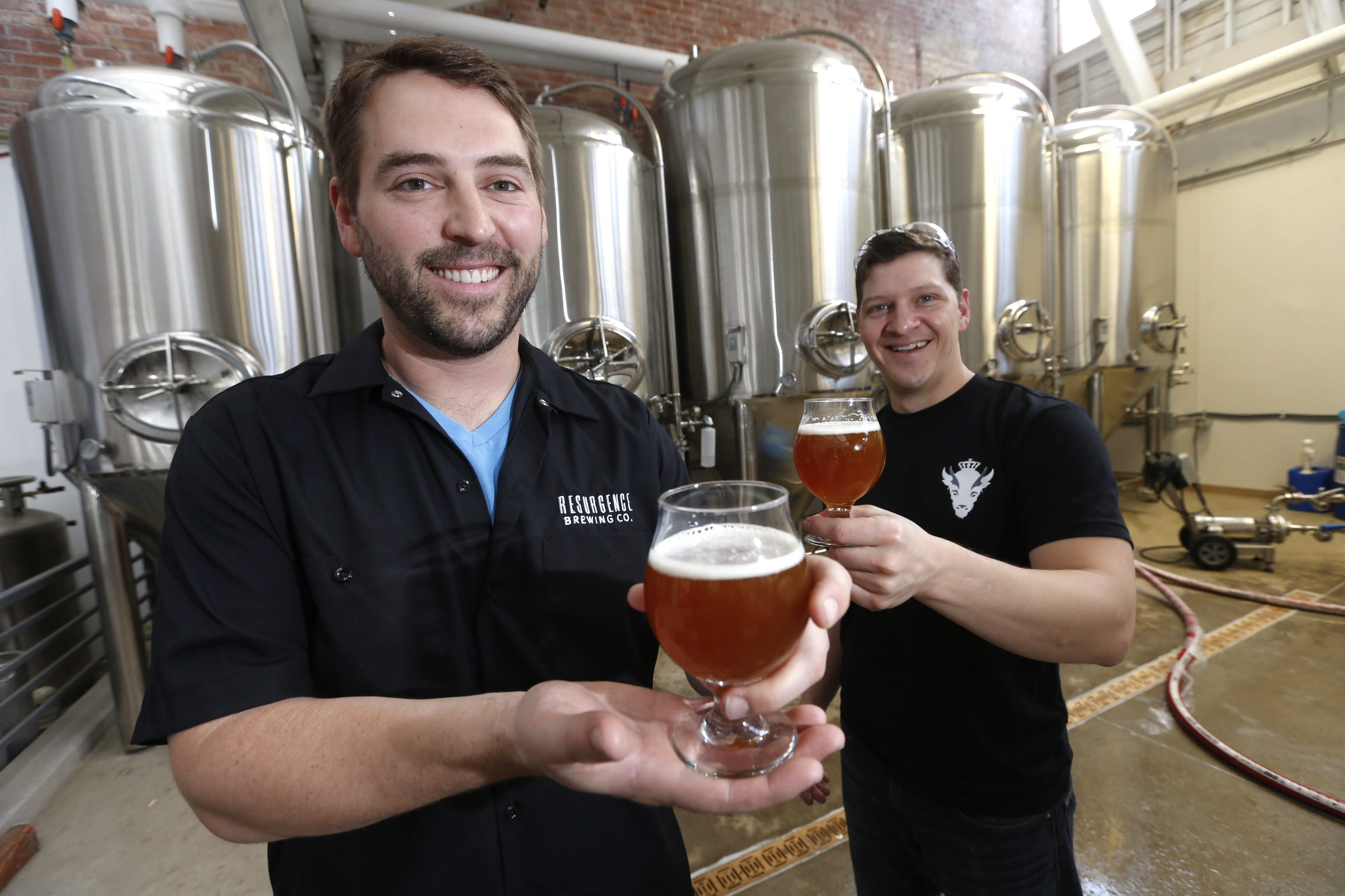 One of the newer craft brewers in Western New York is Resurgence Brewing Co. on Niagara Street. Shown here are owner Jeff Ware, left, and master brewer Dave Collins.