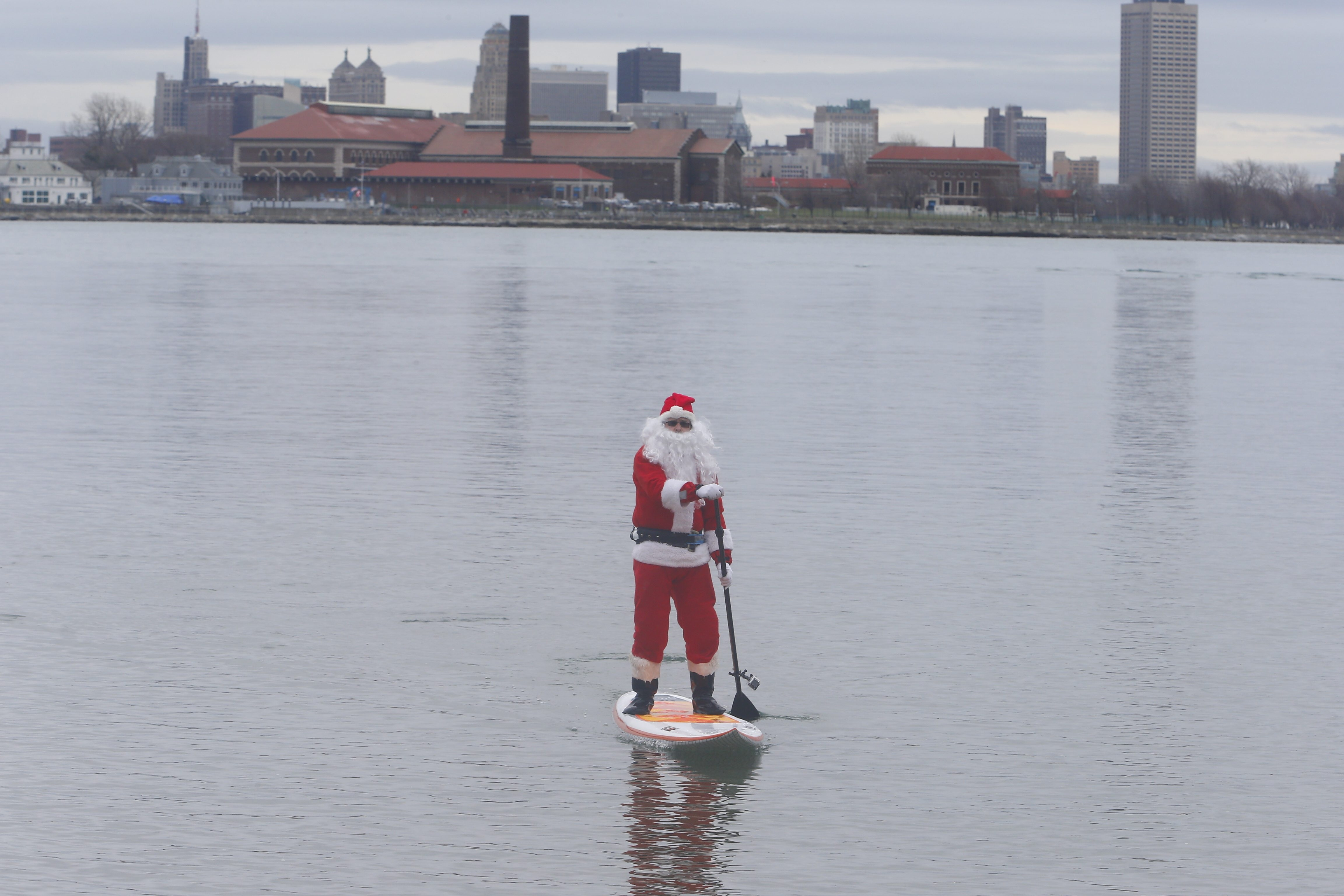 The weather won't be as calm Christmas  Eve and  Christmas Day as it was Tuesday when Surfing Santa aka John Fulton did his annual stunt in the Niagara River  bringing awareness to the homeless at Mather Arch / Niagara River in Fort Erie, Ont. (John Hickey/Buffalo News)