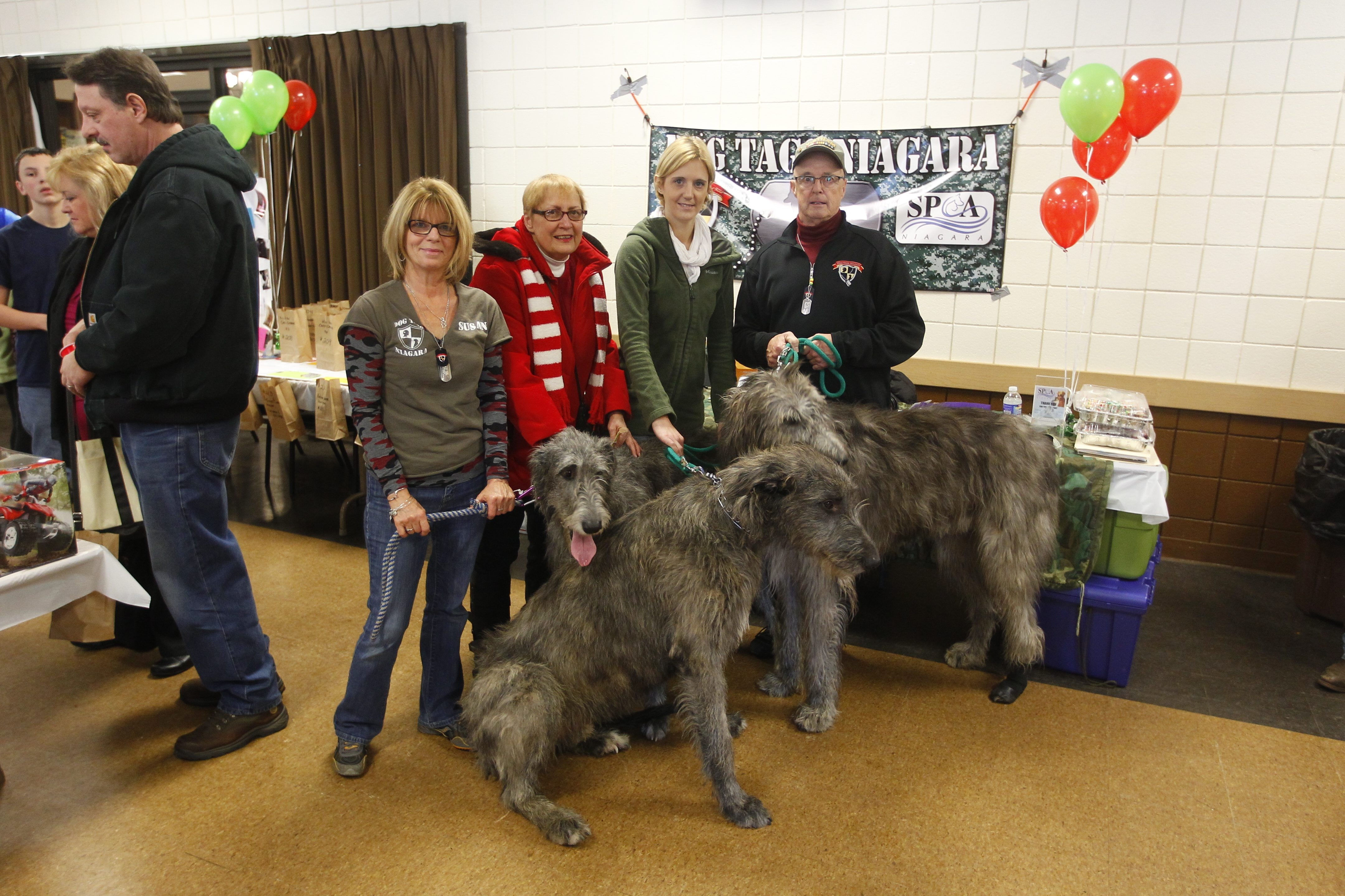 Dog Tags Niagara participants, from left, Susan Alexander, Joyce Odorczyk, Amy Lewis and Joe Ruszala, with Odorczyk's Irish wolfhounds Dulan, Gallagher, and Bellehaven at the Elks Lodge, 1805 Fashion Outlet Blvd., Niagara Falls.