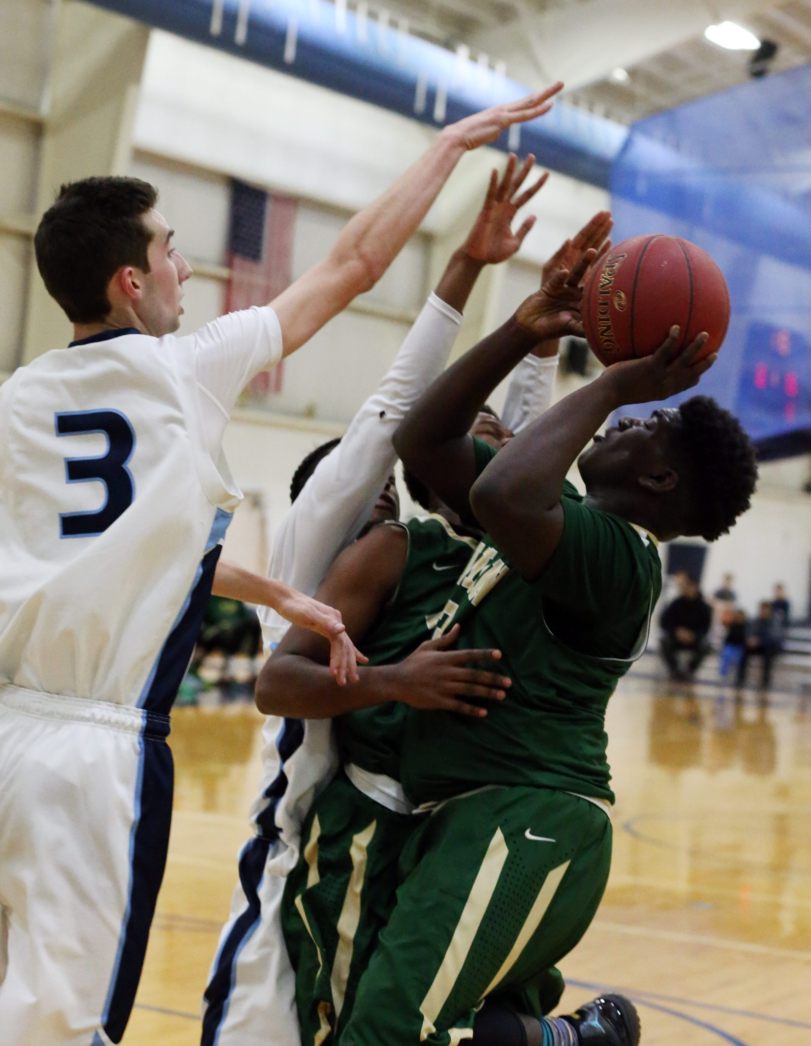 Bishop Timon-St. Jude's Joe Harrison runs into a traffic jam, including St. Mary's Austin Oakes (3) among others. Timon won the game, 82-80, in four overtimes.