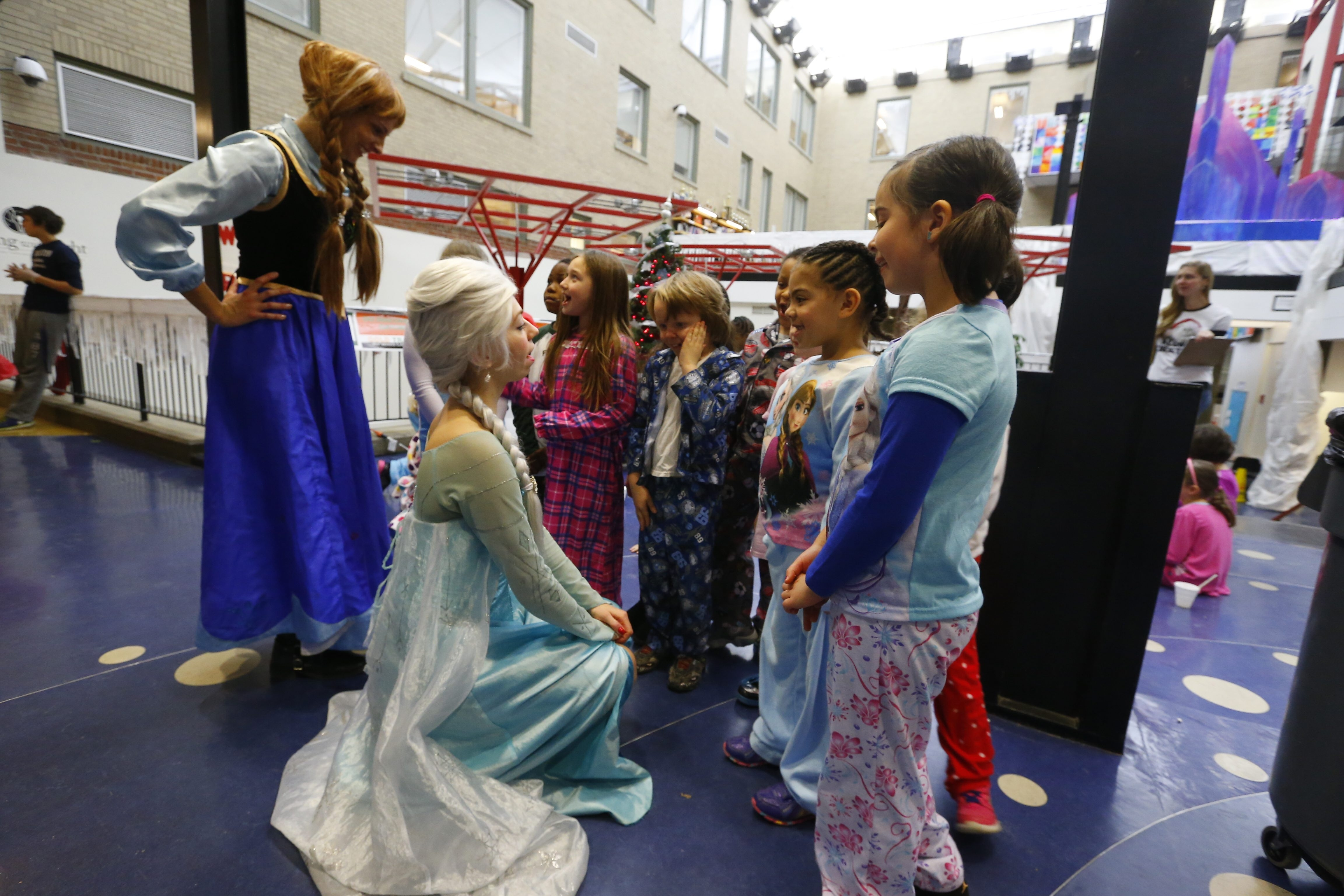 "Students at Discovery School meet ""Frozen"" characters Anna, left, and Elsa on Tuesday. The school combined the ""Frozen"" theme with fun learning activities."
