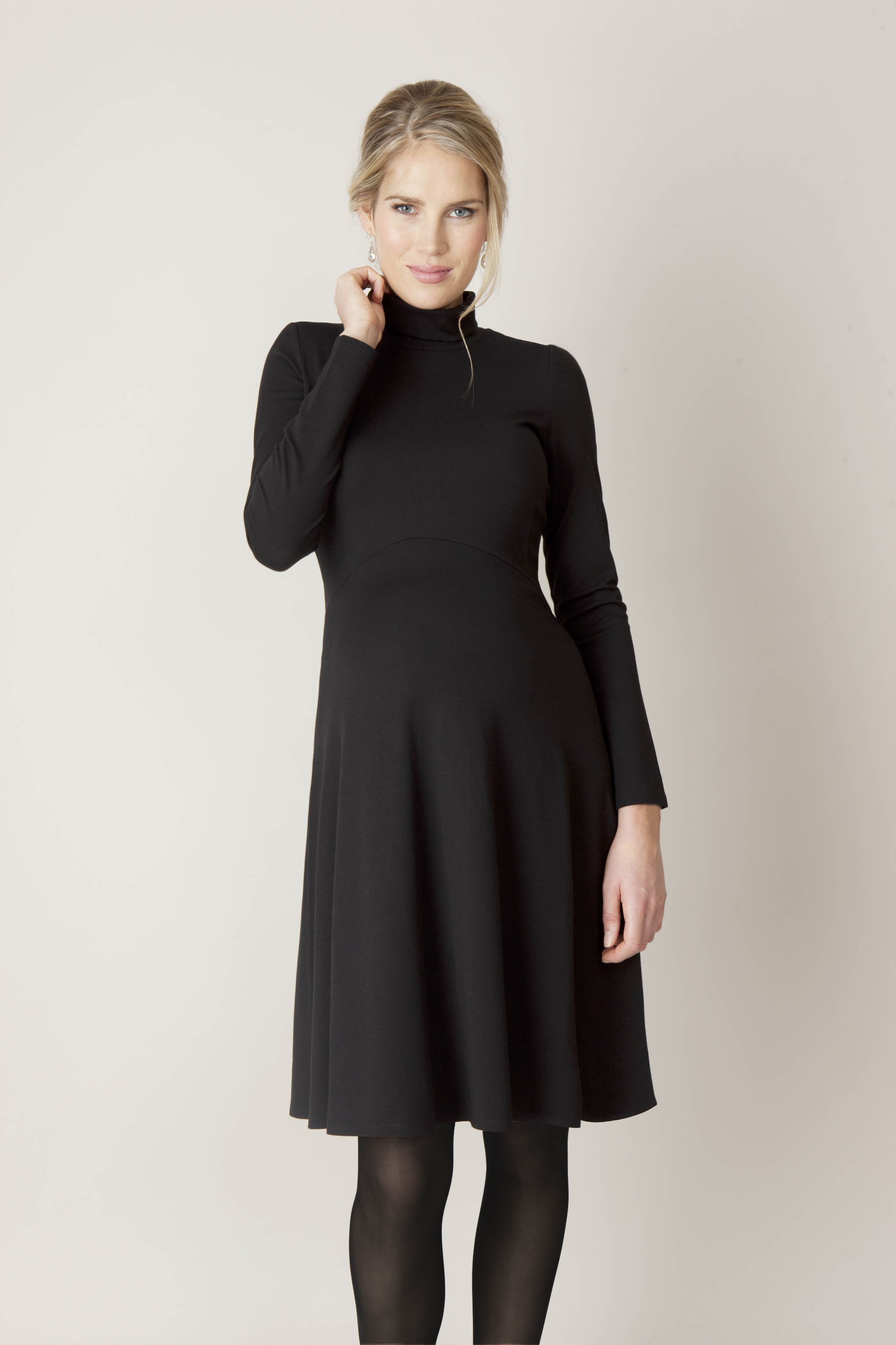 Above, a dress tailored for pregnant women from Seraphine. At right, a coat tailored for pregnant women from Hatch.