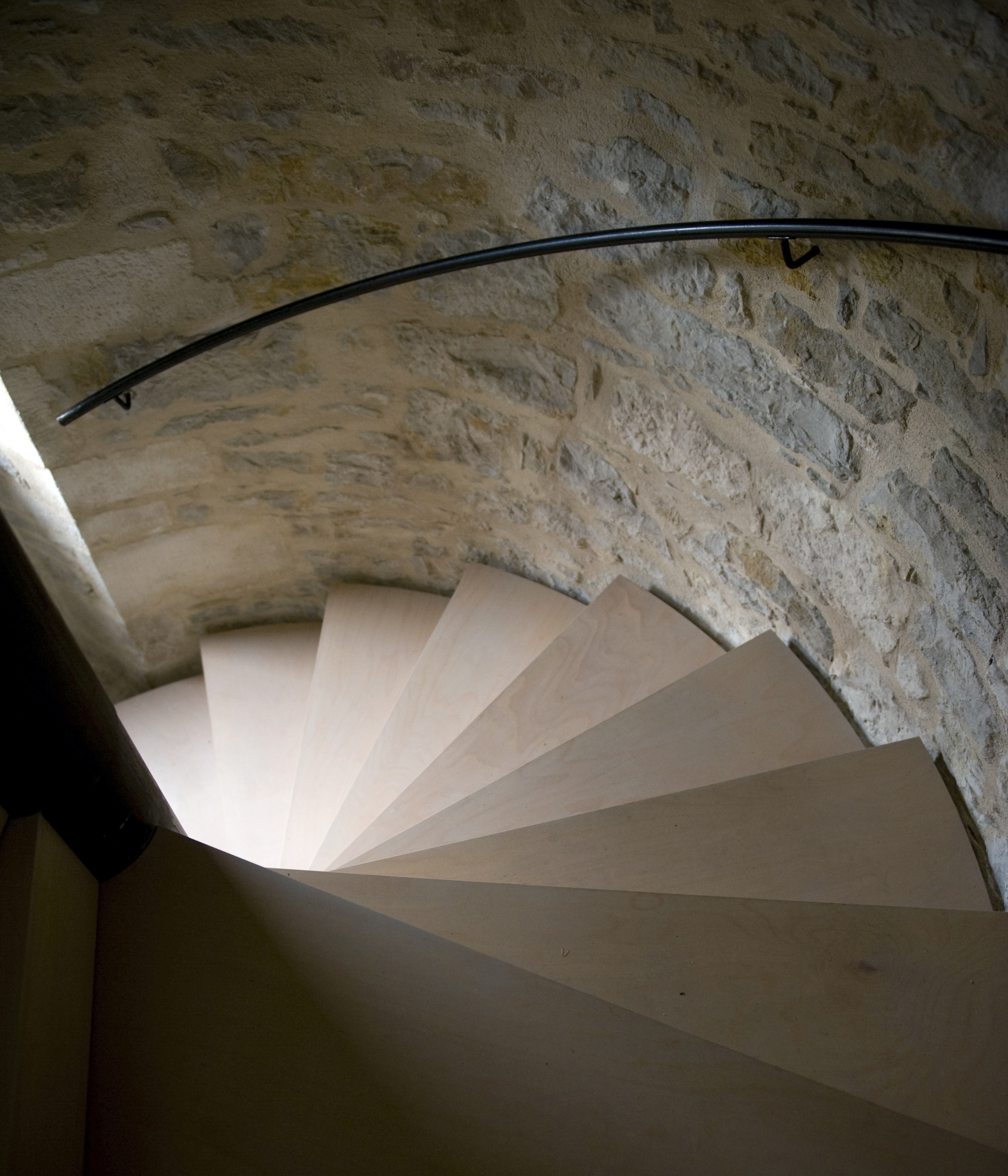 The spiral staircase inside the renovated medieval tower of Pamela and Richard Marshall, in the small village of Montvalent, France, Nov. 25, 2014. The first 16 steps of the spiral staircase are original stone; the remainder are a steel replacement clad in beechwood. (Andrea Wyner/The New York Times)